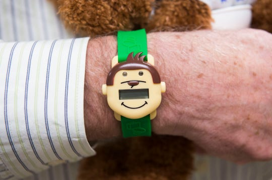 Founder and CEO of PottyMD, Dr. Preston Smith holds the Potty Monkey and wears the Potty Monkey Watch at PottyMD in West Knoxville Tuesday, Feb. 12, 2019. The local company manufactures watches to help potty train children and other members of the population.