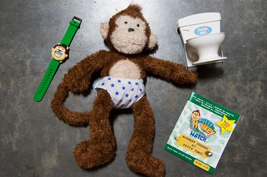 A photo of the Potty Monkey with the Potty Monkey Watch at PottyMD in West Knoxville Tuesday, Feb. 12, 2019. The local company manufactures watches to help potty train children and other members of the population.