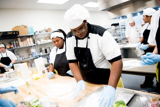Clarance Cunningham kneads the dough to make pasta during a cooking class at Tennessee School for the Deaf Knoxville, in Knoxville, Tennessee on Tuesday, February 12, 2019. Students enrolled in STEP were taking a culinary class through the UT Culinary and Catering Program.