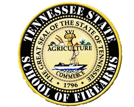 The Tennessee State School of Firearms seal.