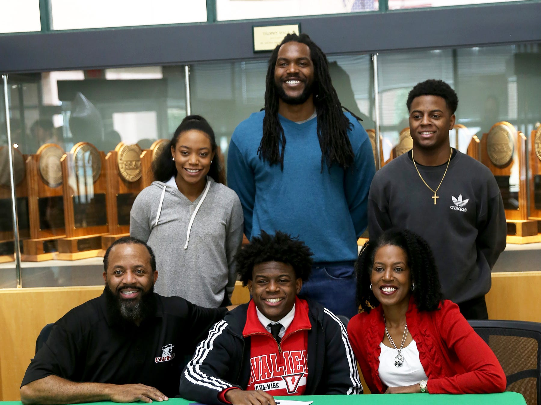 Webb senior running back/defensive back Jahlil Jefferson signed with University of Virginia's College at Wise on Feb. 6. With him (seated) are his father, Valentino Jefferson, and mother, Nickola Jefferson; (standing, from left) sister Jasmine Jefferson; brothers Josh Gregory and Juwaan Jefferson.