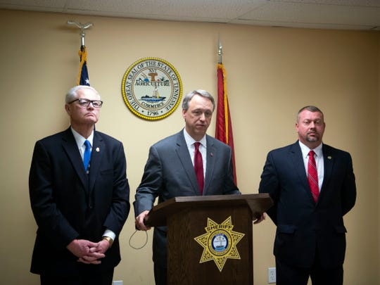 Steve Crump, 10th Judicial District attorney general, center, along with Criminal Investigator Calvin Rockholt, left, and Monroe County Sheriff Tommy Jones during a news conference regardingcc Max Benson Calhoun who is charged with the 1973 death of John Raymond Constant Jr. on Tuesday, February 12, 2019.