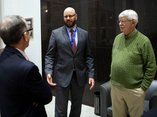 News Sentinel executive editor Joel Christopher, center, chats with outgoing editor Jack McElroy, left, and retired cartoonist Charlie Daniel on Monday, February 11, 2019 during a reception recognizing McElroy and Daniel's work and also to welcome Christopher.