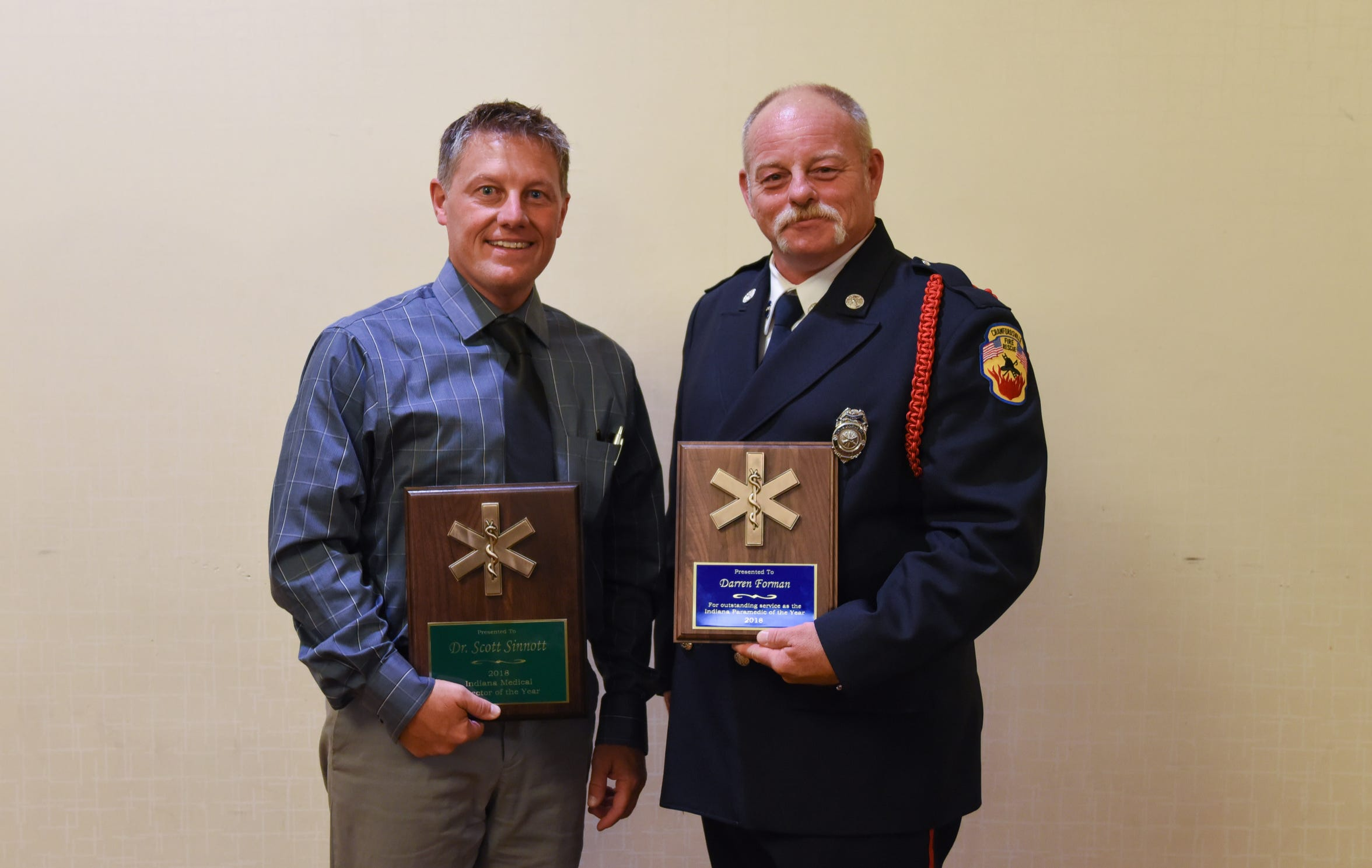 Dr. Scott Sinnott, left, and paramedic Darren Forman, right, were awarded statewide honors for their involvement in Project Swaddle.