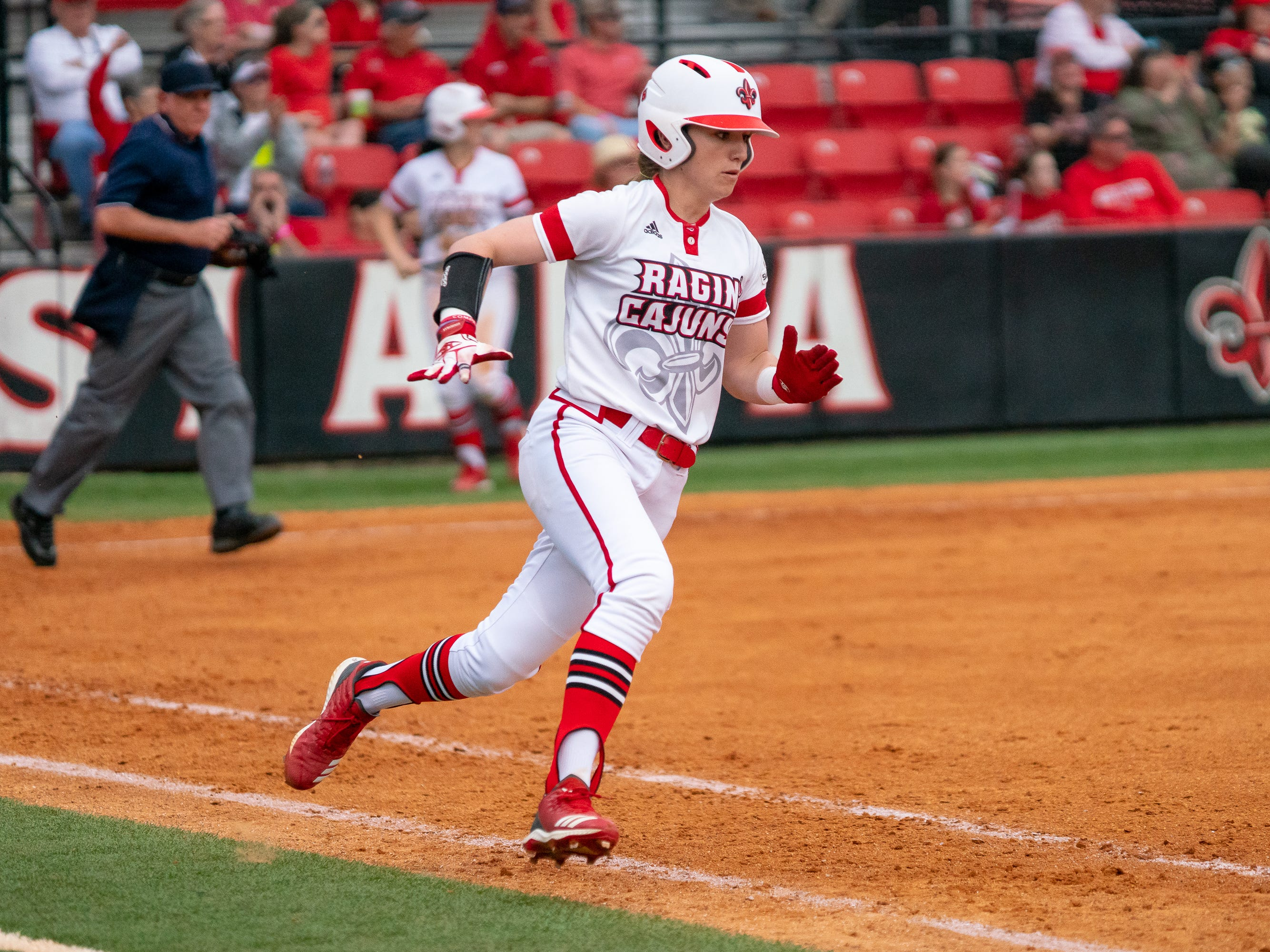 UL's Sarah Hudek runs to first base after hitting the ball as the Ragin' Cajuns play against the California Golden Bears at Lamson Park on February 11, 2019.
