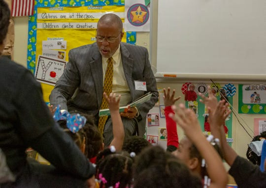 Sen. Gerald Boudreaux reads a book to a class of three-year-olds at the Gethsemane LaPetite Early Childhood Development Center following a summit on early childhood education.