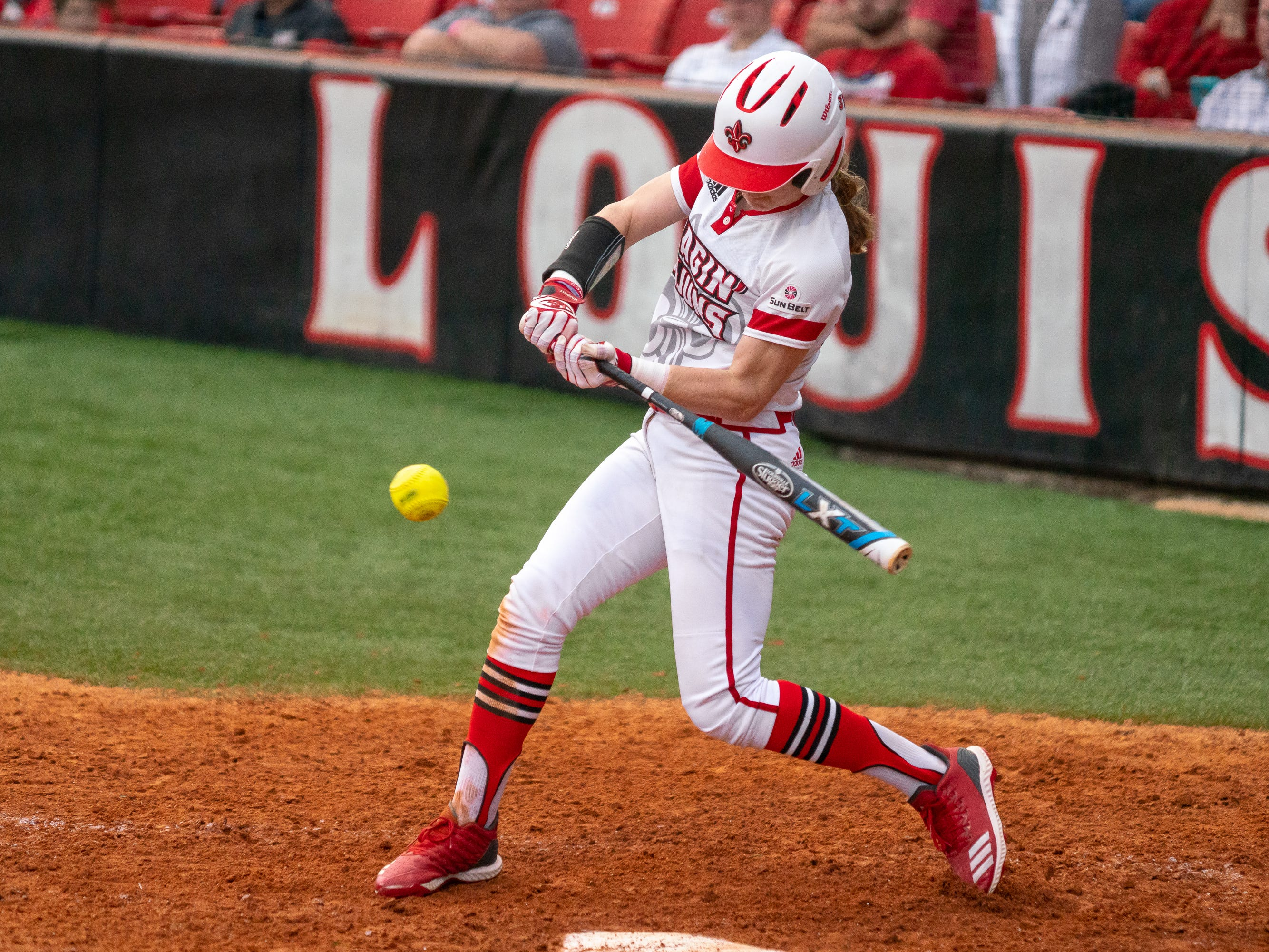 UL's Sarah Hudek takes a swing at the pitch as the Ragin' Cajuns play against the California Golden Bears at Lamson Park on February 11, 2019.
