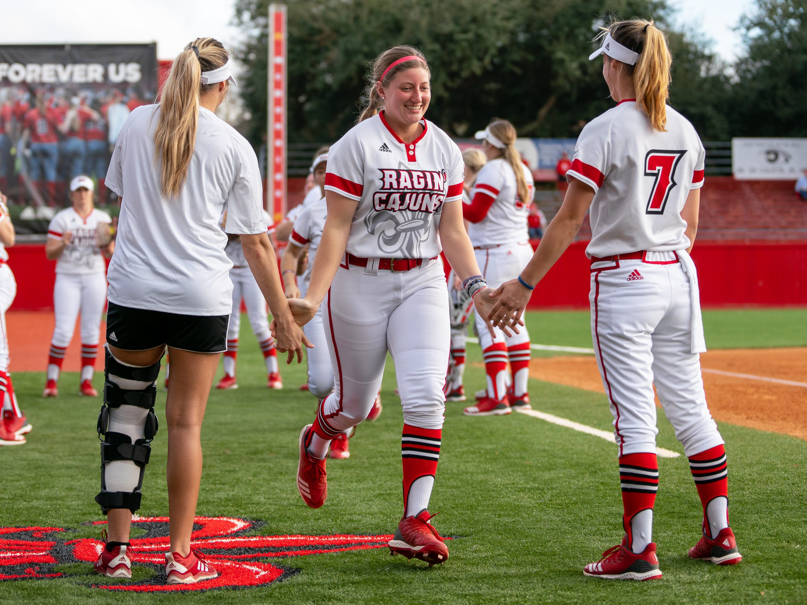 UL's Carrie Boswell runs onto the field before the game as the Ragin' Cajuns play against the California Golden Bears at Lamson Park on February 11, 2019.