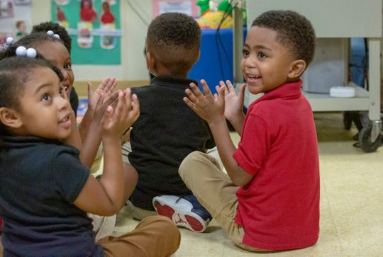 Students from a class of three-year-olds at the Gethsemane LaPetite Early Childhood Development Center clap for a few guests.