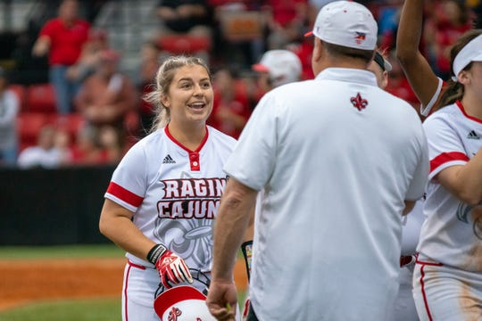 UL's Lexie Comeaux celebrates with head coach Gerry Glasco after hitting her third homerun of the season as the Ragin' Cajuns play against the California Golden Bears at Lamson Park on February 11, 2019.