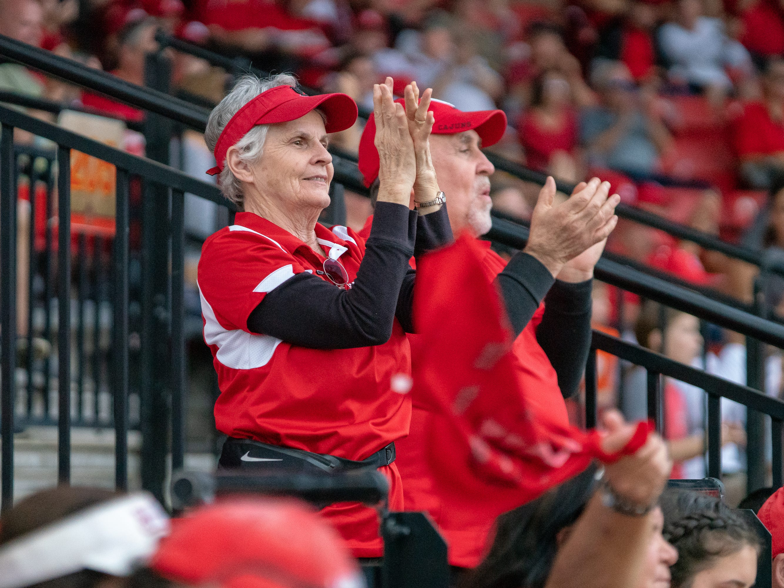 Fans cheering on UL in the stands as the Ragin' Cajuns play against the California Golden Bears at Lamson Park on February 11, 2019.