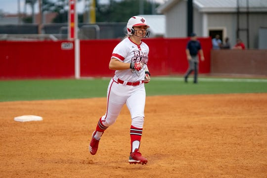 UL's Lexie Comeaux rounds the bases after hitting a homerun as the Ragin' Cajuns play against the California Golden Bears at Lamson Park on February 11, 2019.