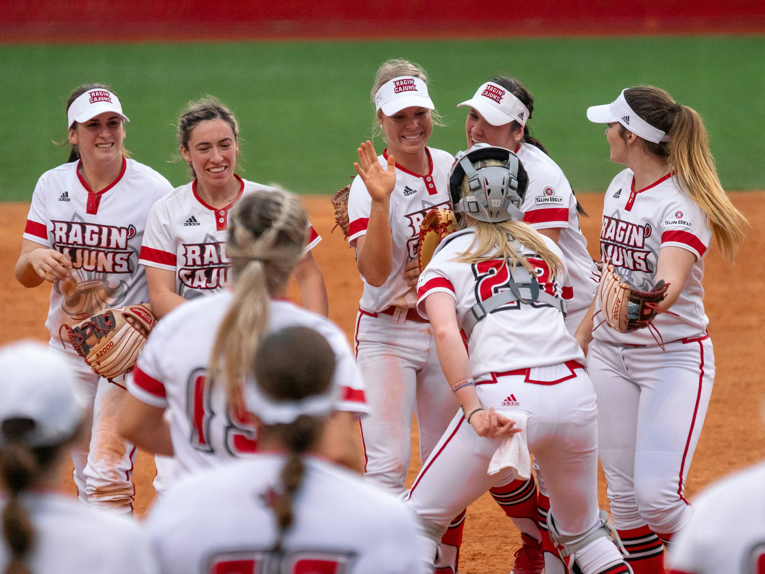 UL's Casidy Chaumont celebrates her catch with her teammates as the Ragin' Cajuns play against the California Golden Bears at Lamson Park on February 11, 2019.