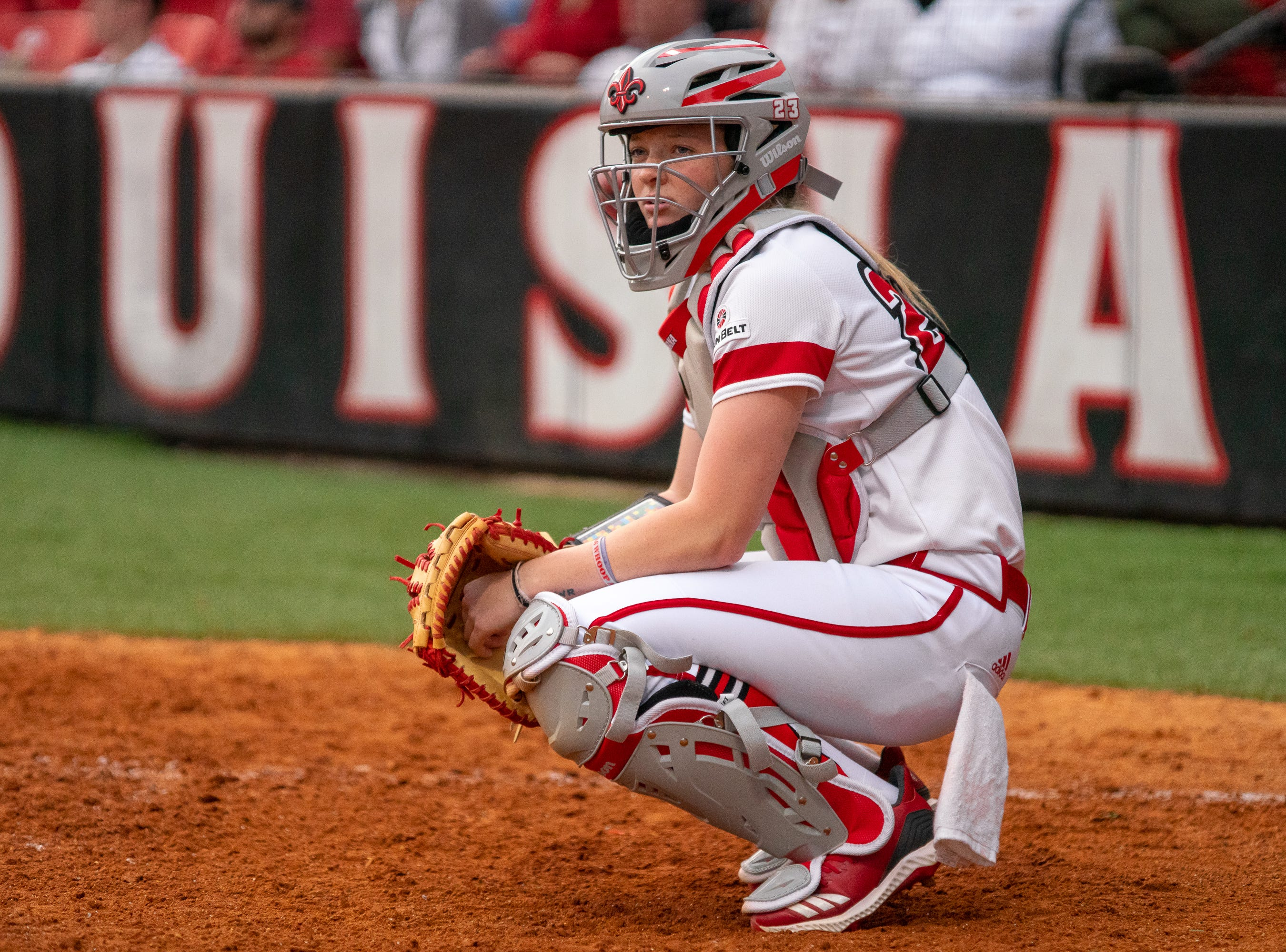 UL's catcher Julie Rawls looks to her coaches in the dugout before the pitch as the Ragin' Cajuns play against the California Golden Bears at Lamson Park on February 11, 2019.