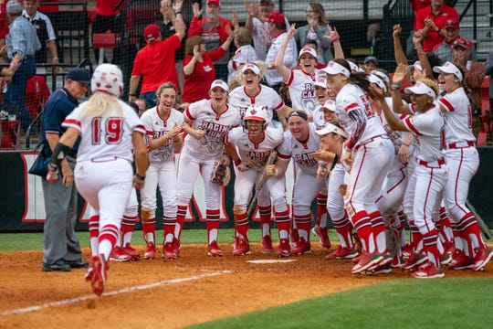 UL clears the dugout and welcomes Lexie Comeaux at home plate as the Ragin' Cajuns play against the California Golden Bears at Lamson Park on February 11, 2019.