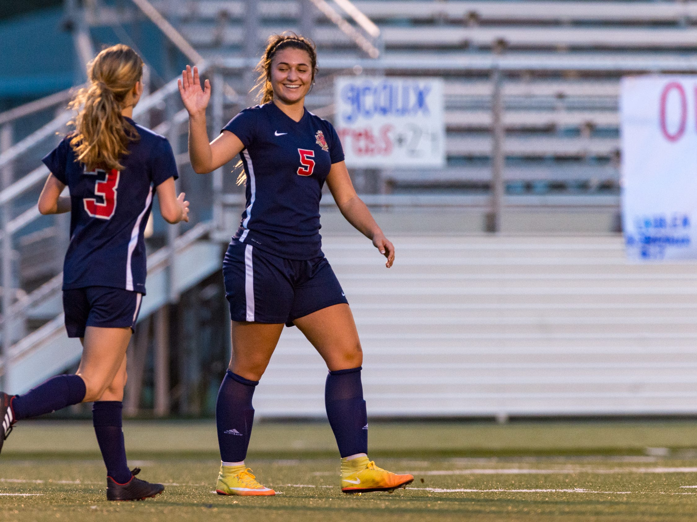 Julia Colette high five to Emily Sonnier after scoring a goal as Teurlings Catholic girls soccer takes down Holy Savior Menard in the quarterfinals of the LHSAA soccer playoffs. Monday, Feb. 11, 2019.