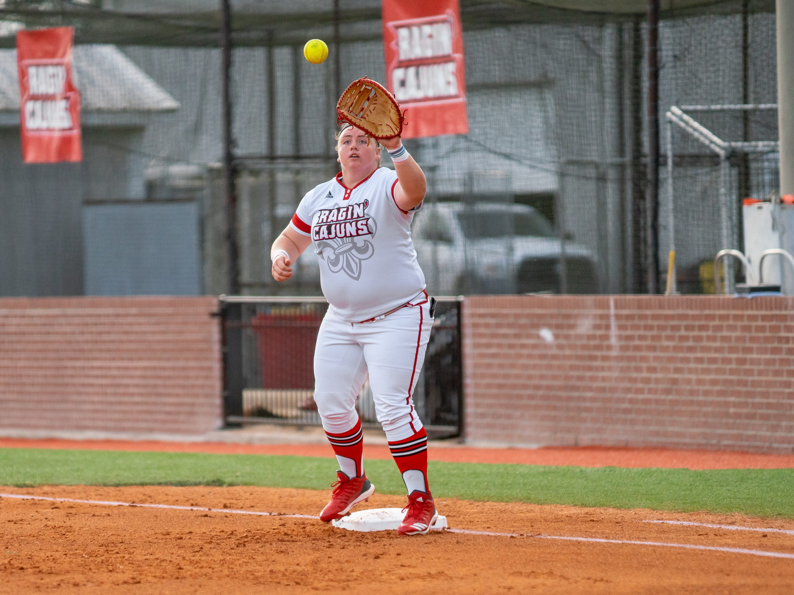 UL's Bailey Curry makes a catch at first base as the Ragin' Cajuns play against the California Golden Bears at Lamson Park on February 11, 2019.