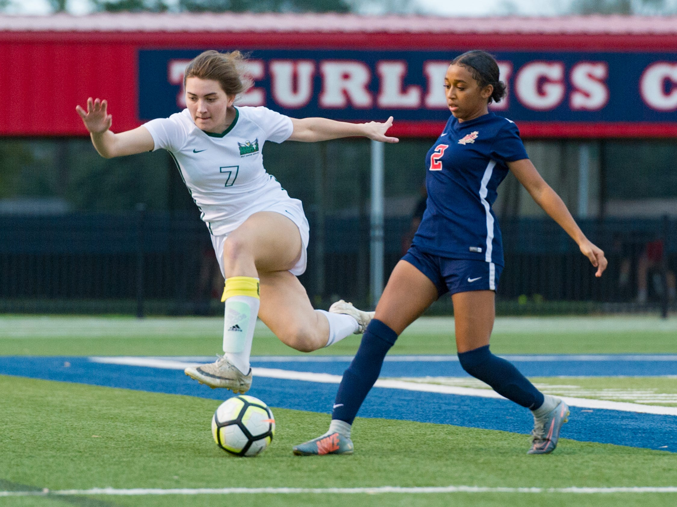 Camryn Chretien takes out defender Anna Robertson as Teurlings Catholic girls soccer takes down Holy Savior Menard in the quarterfinals of the LHSAA soccer playoffs. Monday, Feb. 11, 2019.