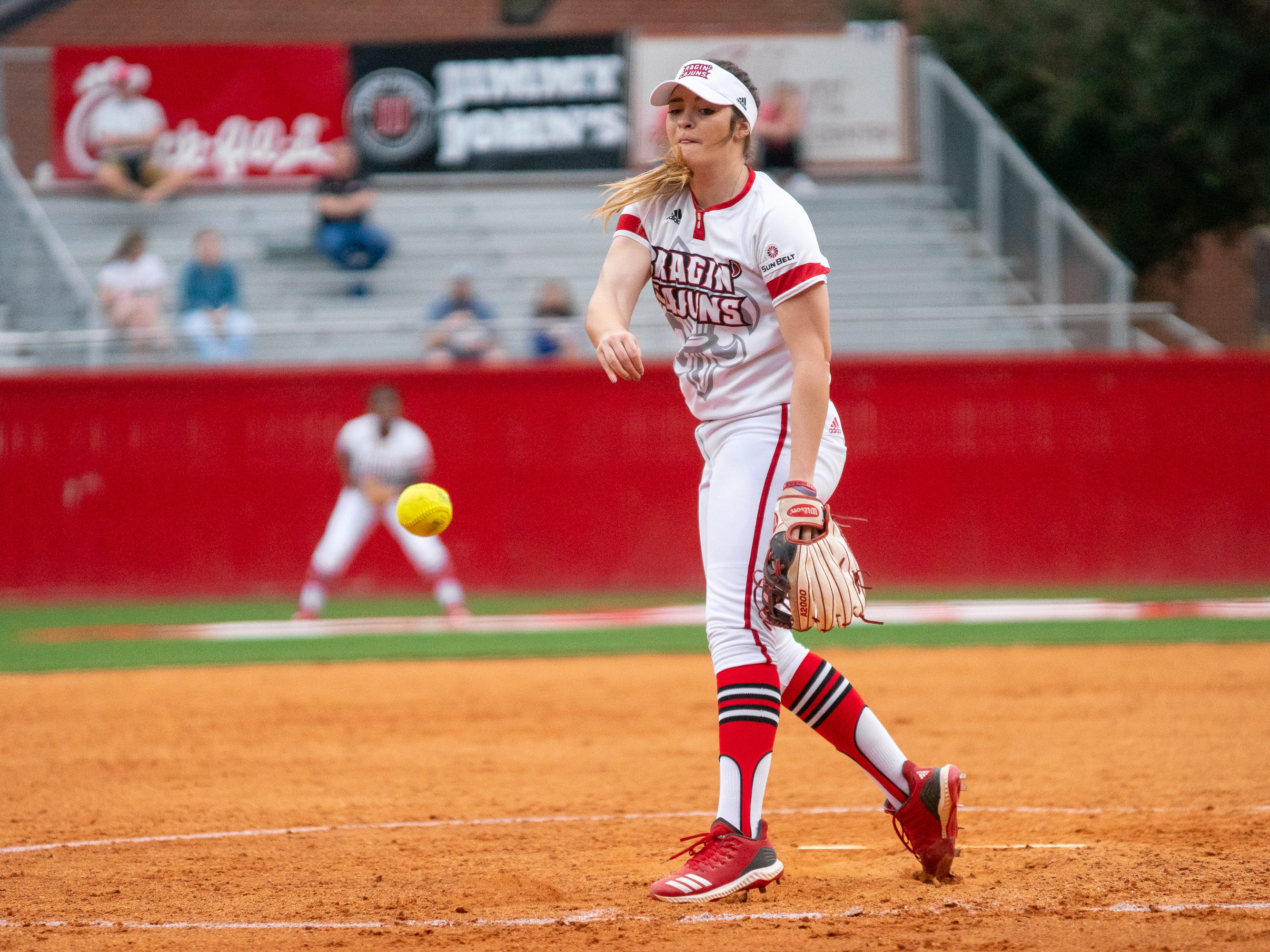 UL's pitcher Summer Ellyson throws the ball towards home plate as the Ragin' Cajuns play against the California Golden Bears at Lamson Park on February 11, 2019.