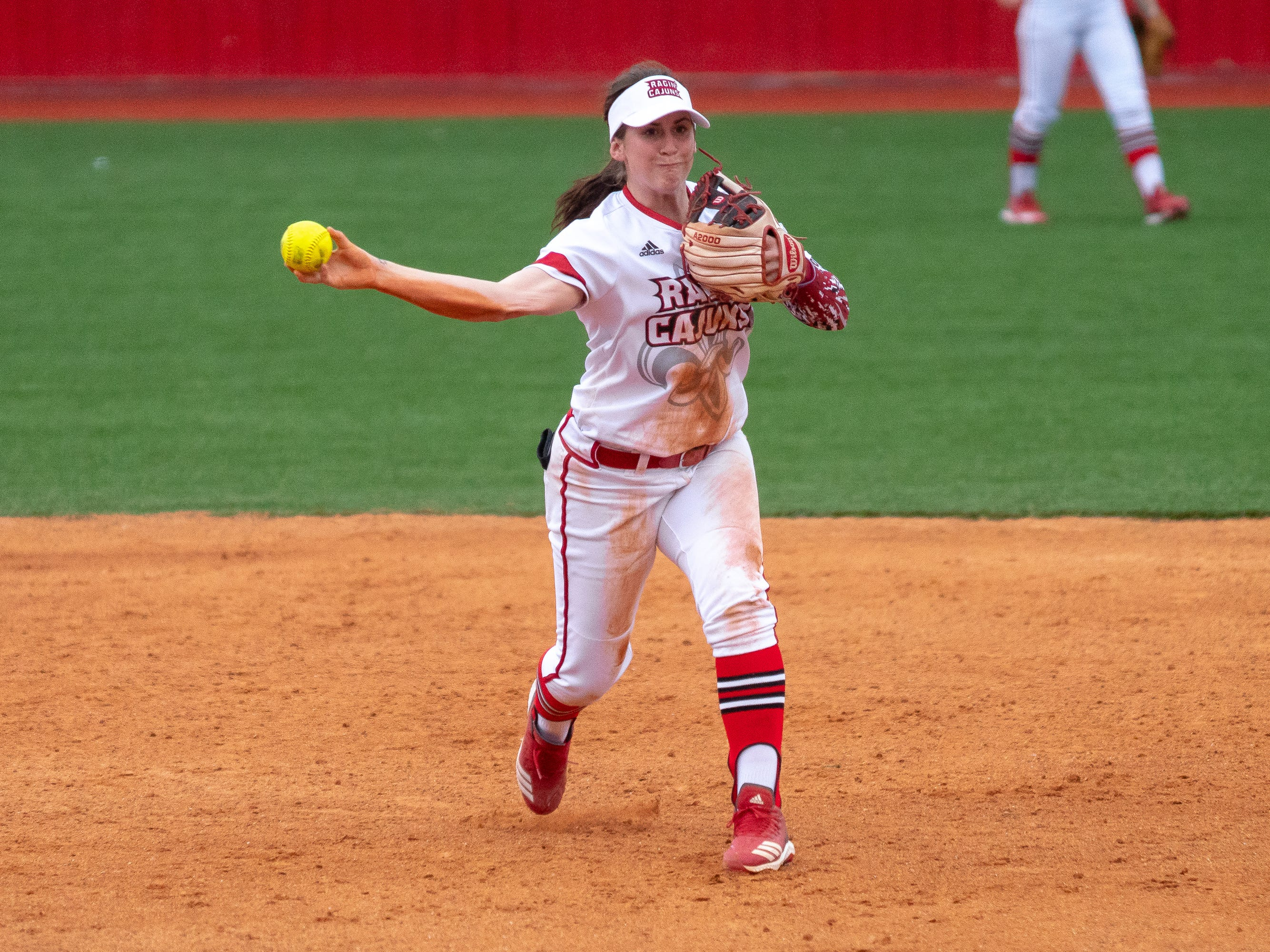 UL's Alissa Dalton throws the ball to first base as the Ragin' Cajuns play against the California Golden Bears at Lamson Park on February 11, 2019.