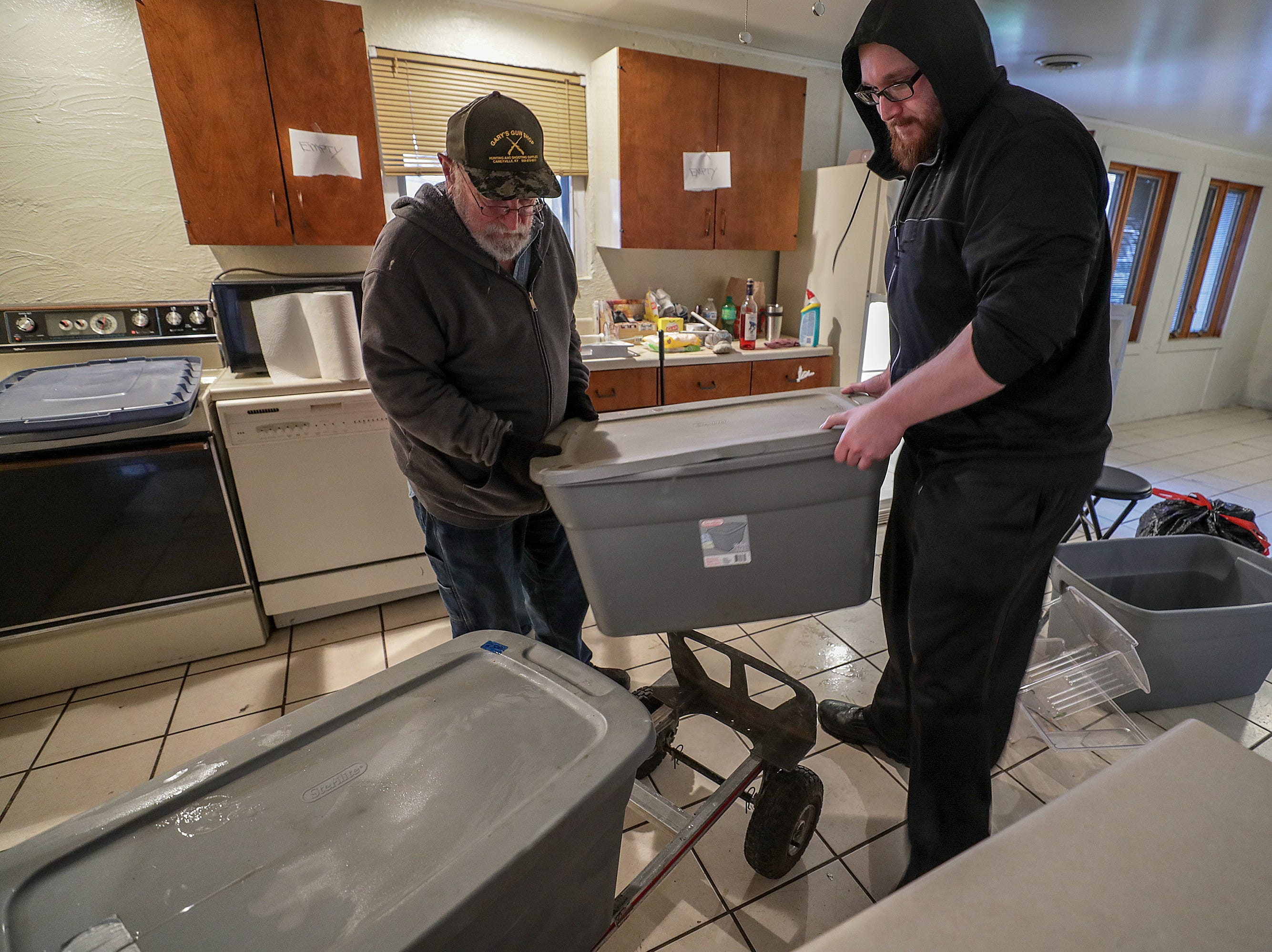 Charlie Anderson and John Killian help members of their family move from their rented home in West Point.  The advancing Ohio River is forcing many to leave their homes in the small river town.February 12, 2019