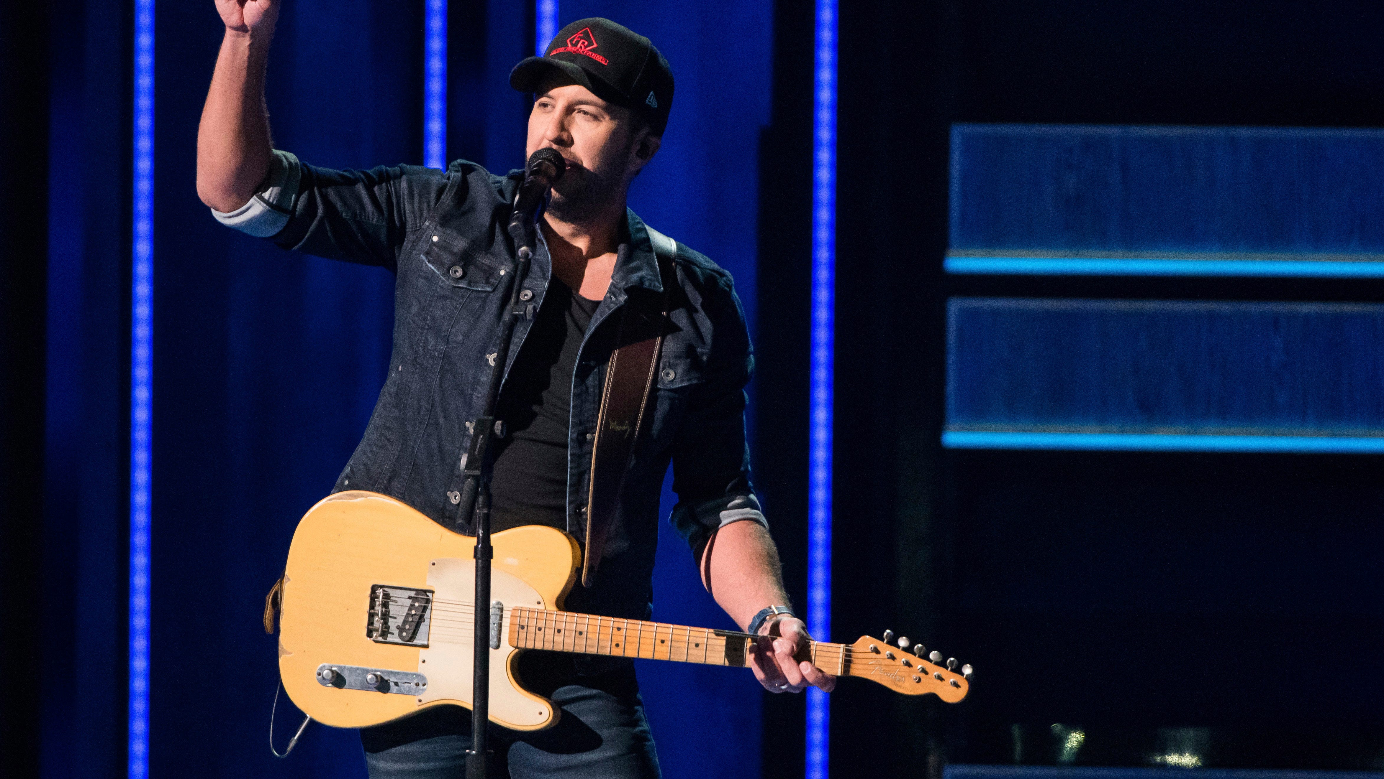 """Luke Bryan performs """"What Makes You Country"""" at the 52nd annual CMA Awards at Bridgestone Arena on Wednesday, Nov. 14, 2018, in Nashville, Tenn. (Photo by Charles Sykes/Invision/AP)"""