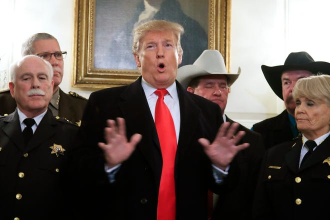 President Donald Trump speaks during a meeting with a group of sheriffs from around the country before leaving the White House in Washington, Monday, Feb. 11, 2019, for a trip to El Paso, Texas.