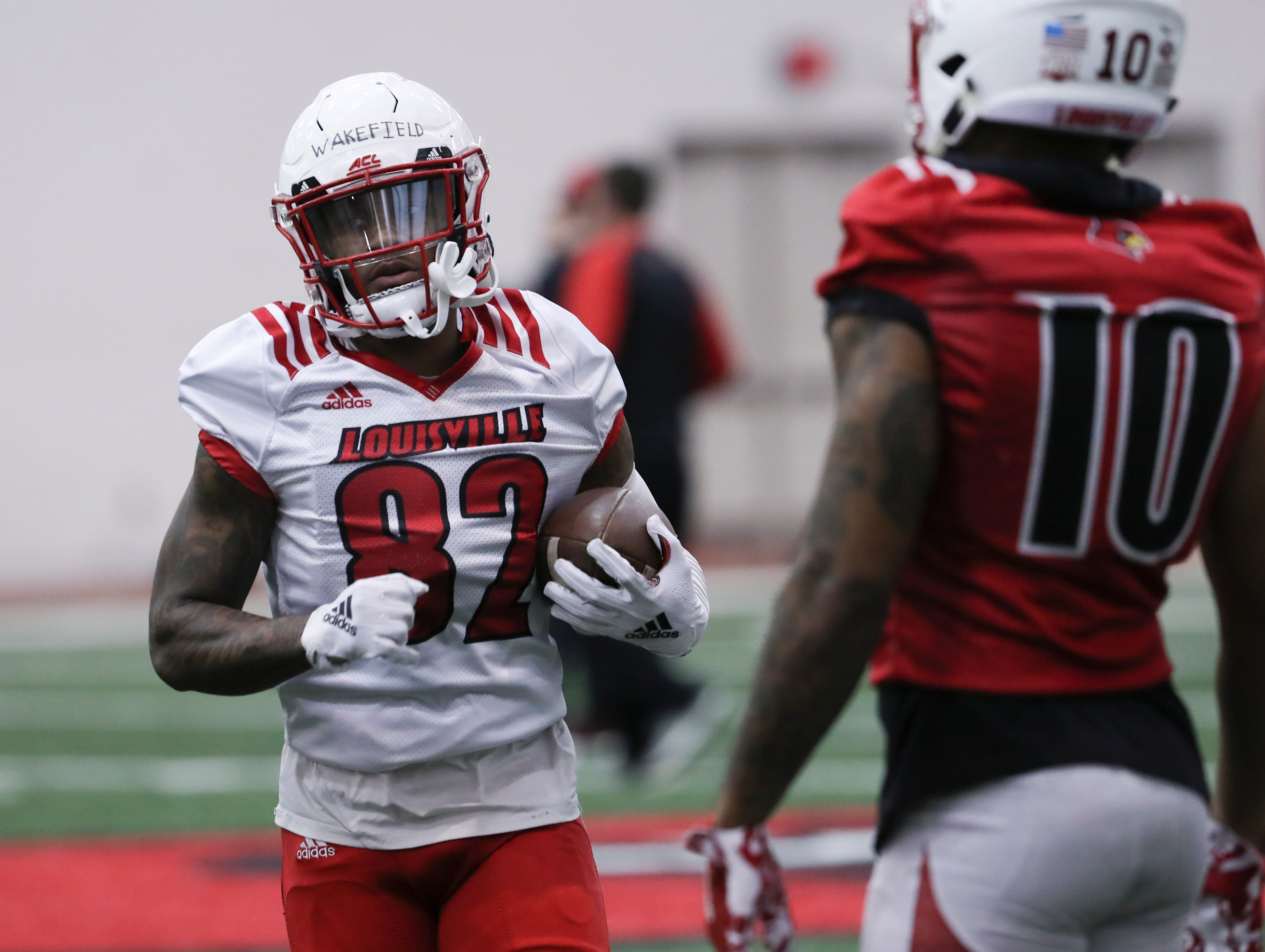U of L's Keion Wakefield (82) ran a pass route during practice at the Trager Center.
