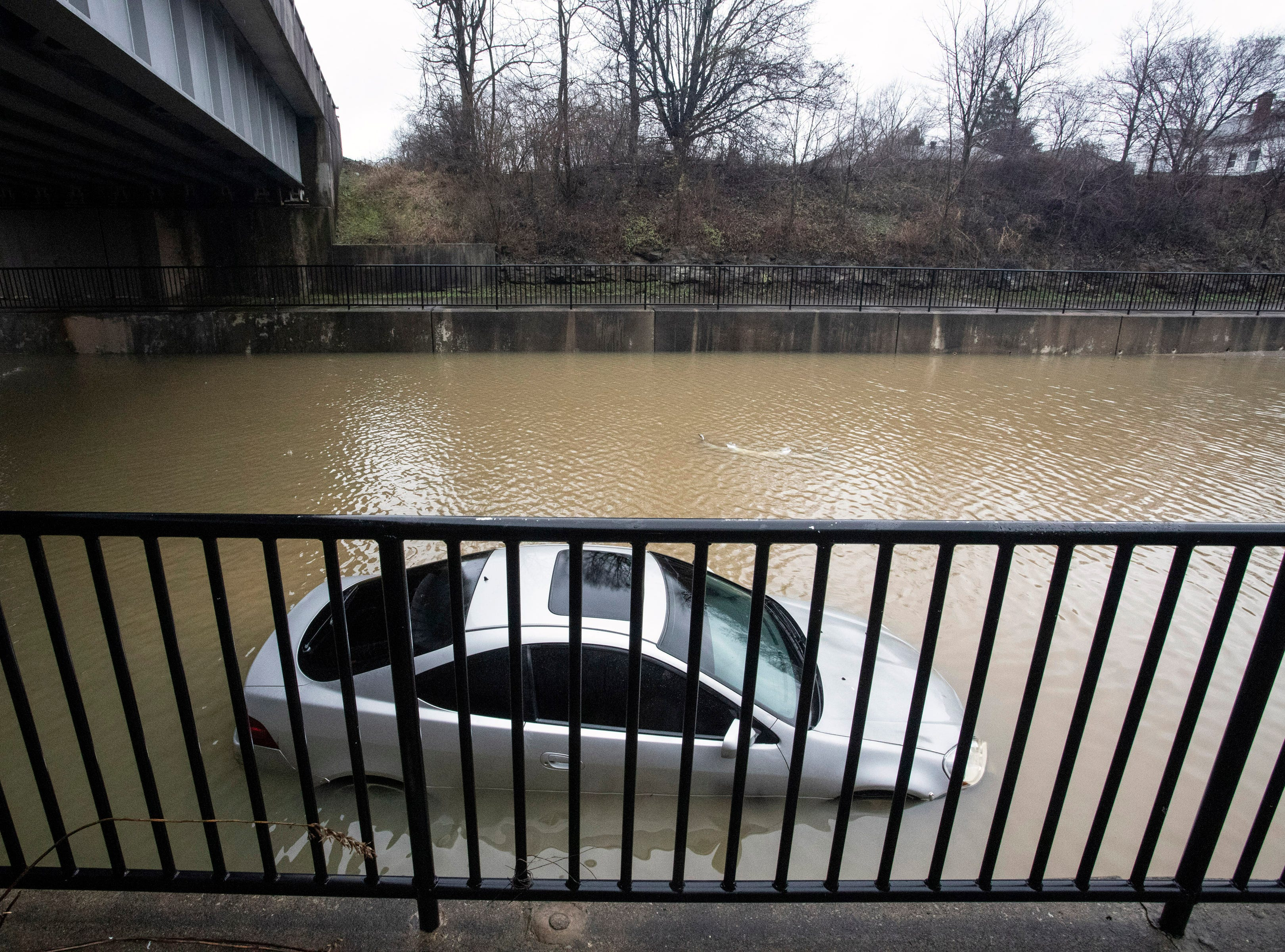 A section of Breckenridge Lane at Six Mile Lane claimed a vehicle when a nearby pumping station failed to sense rising waters on Tuesday morning. 2/12/19
