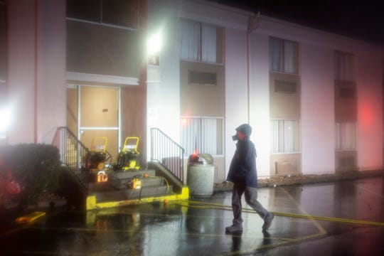 An arson investigator walked past the Ramada Inn, in Jeffersontown, where a fire broke out in one of the rooms this morning. Feb. 12, 2019