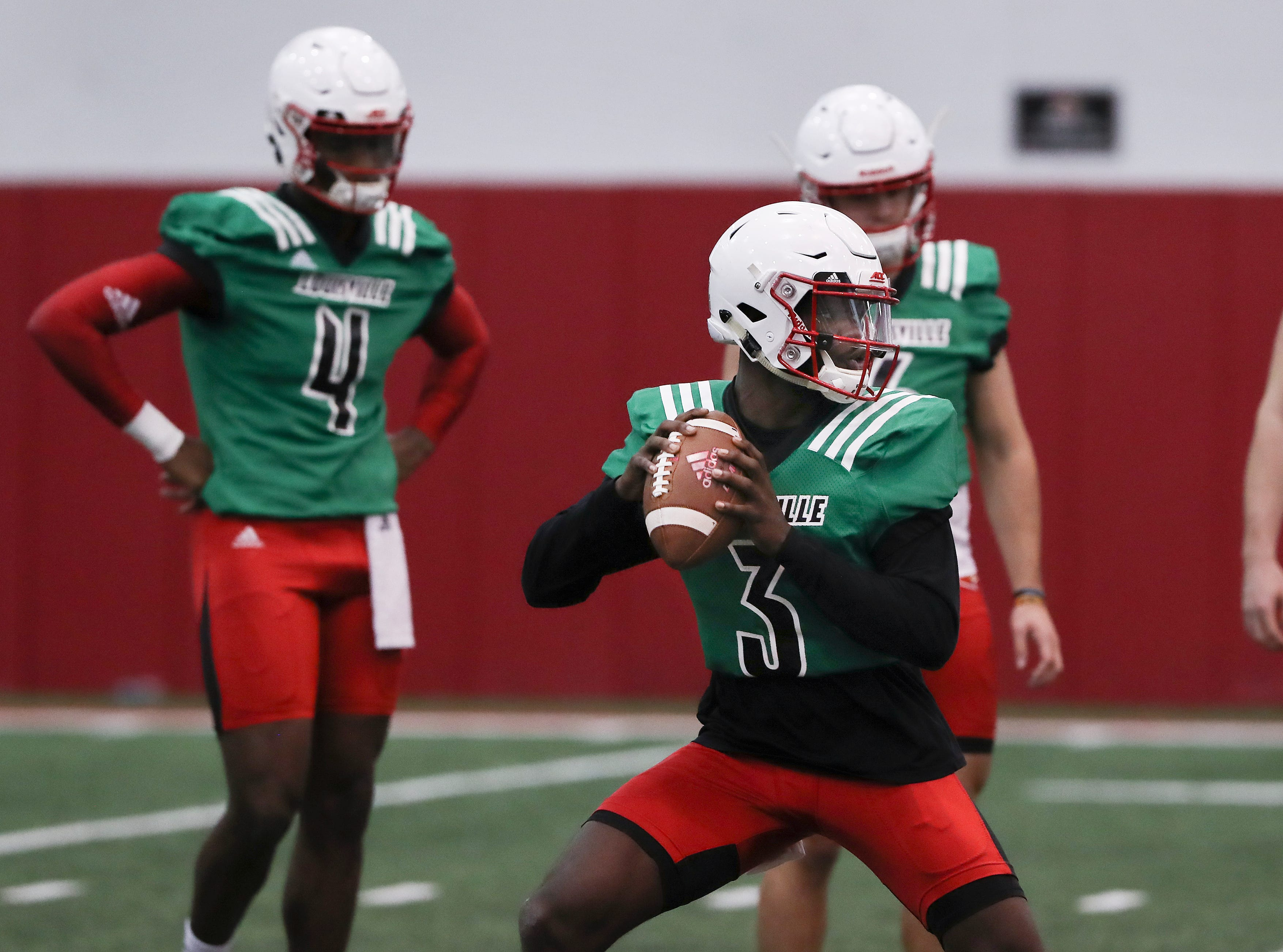 U of L QB Malik Cunningham (3) performs a pass drill during practice at the Trager Center.