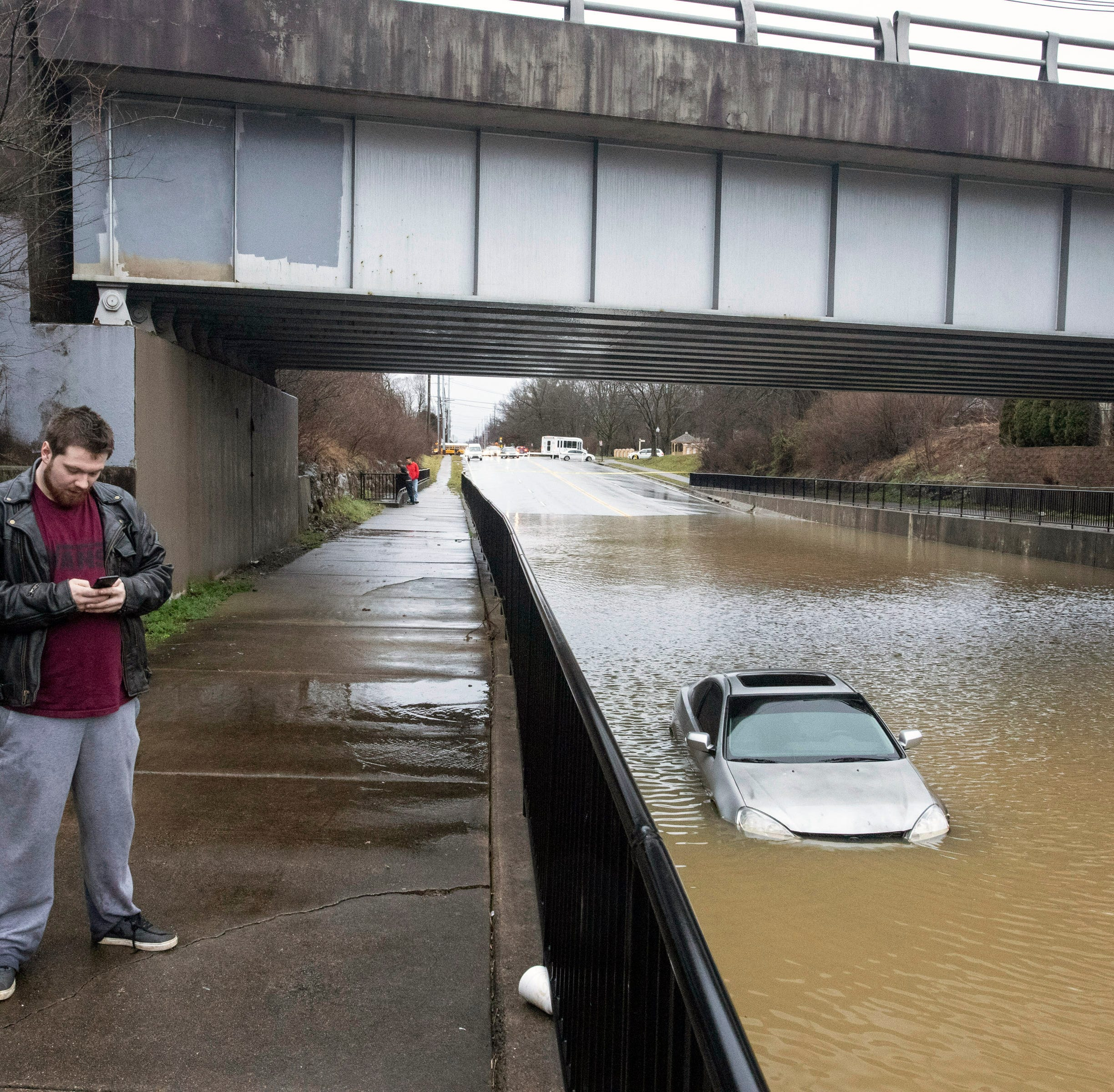 His car was destroyed at a flooded intersection. So where were the warnings?