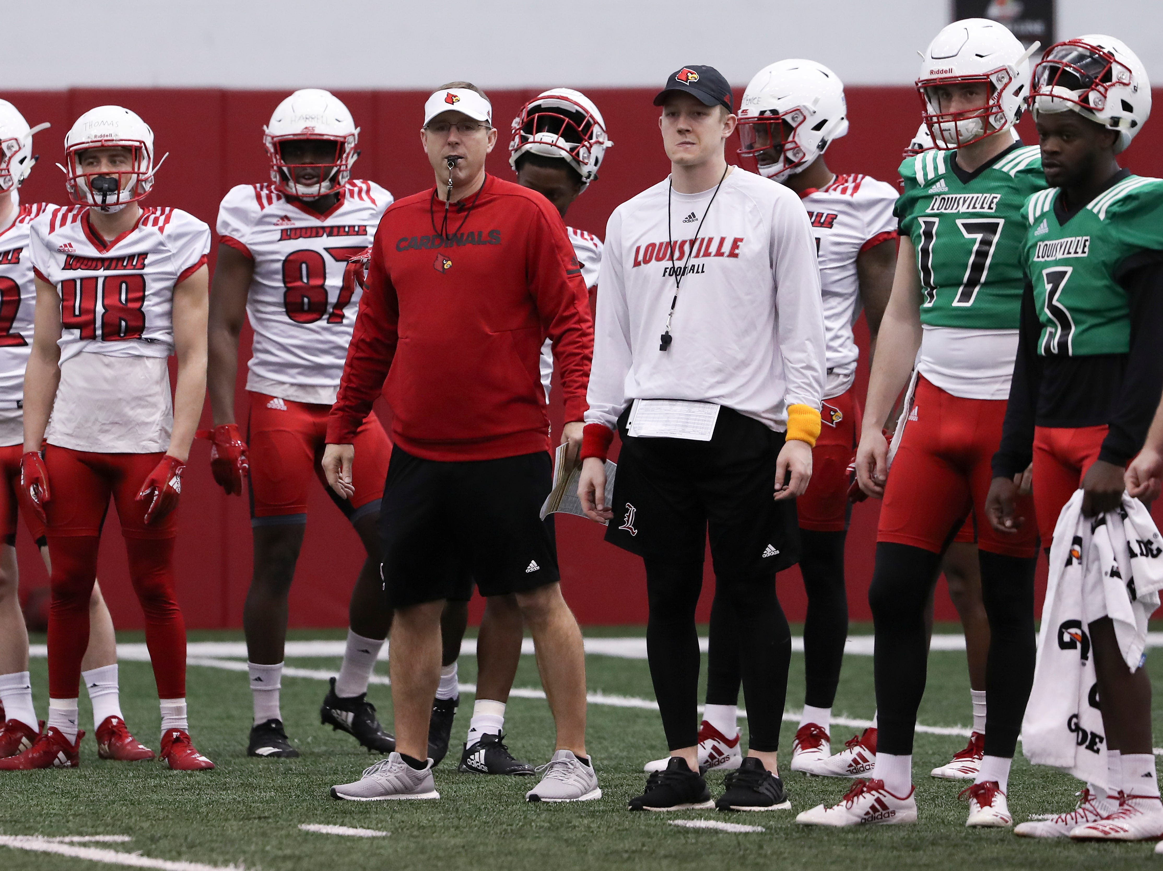 U of L head coach Scott Satterfield, center with whistle in mouth, observed the offense during practice at the Trager Center.