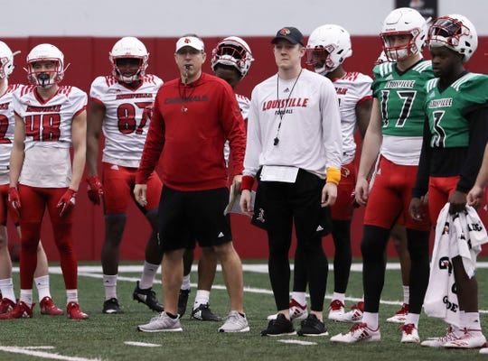 U of L head coach Scott Satterfield, center with whistle in mouth, observed the offense during practice at the Trager Center.Feb. 11, 2019