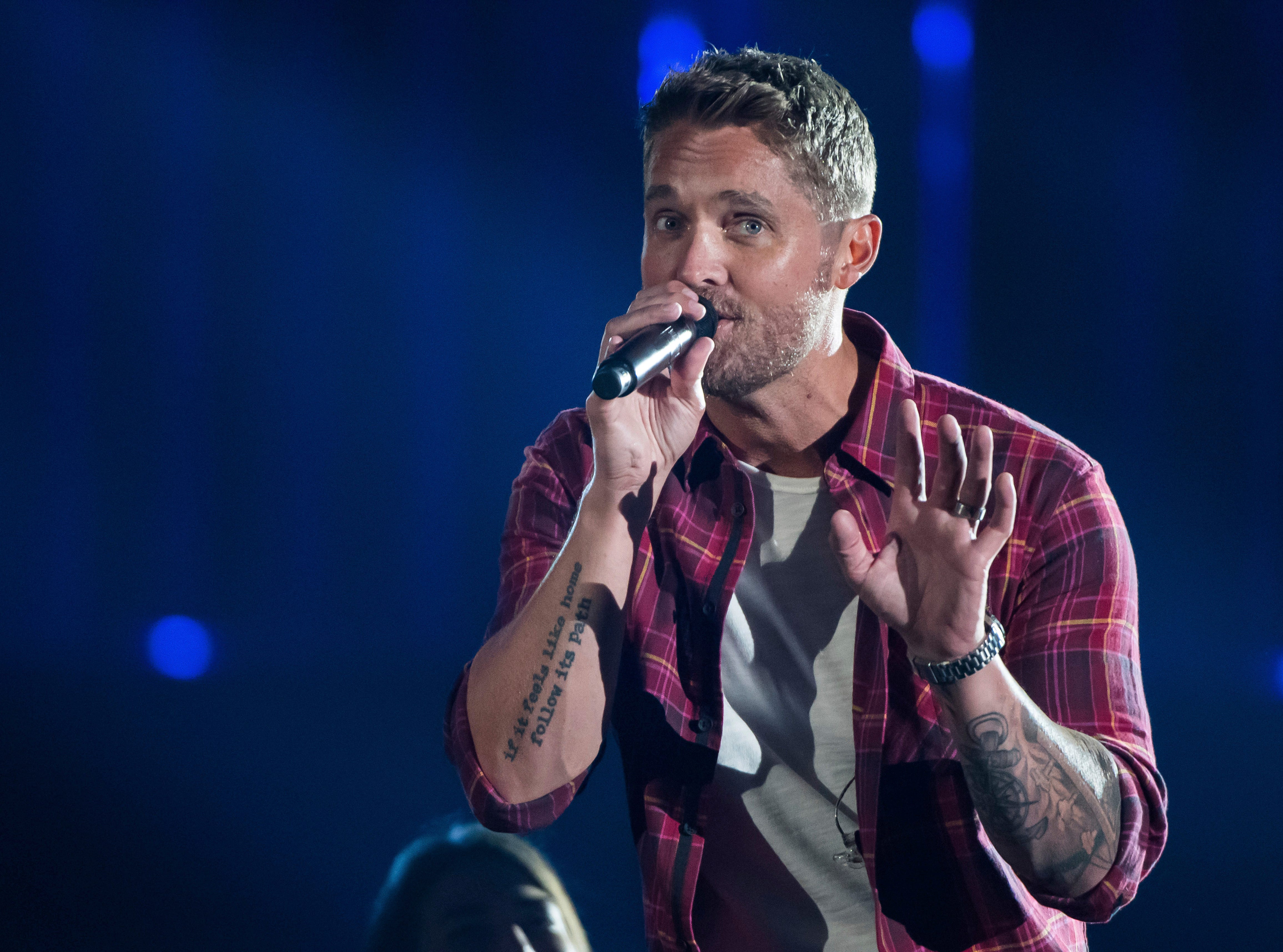 "Brett Young performs ""Mercy"" at the 52nd annual CMA Awards at Bridgestone Arena on Wednesday, Nov. 14, 2018, in Nashville, Tenn. (Photo by Charles Sykes/Invision/AP)"