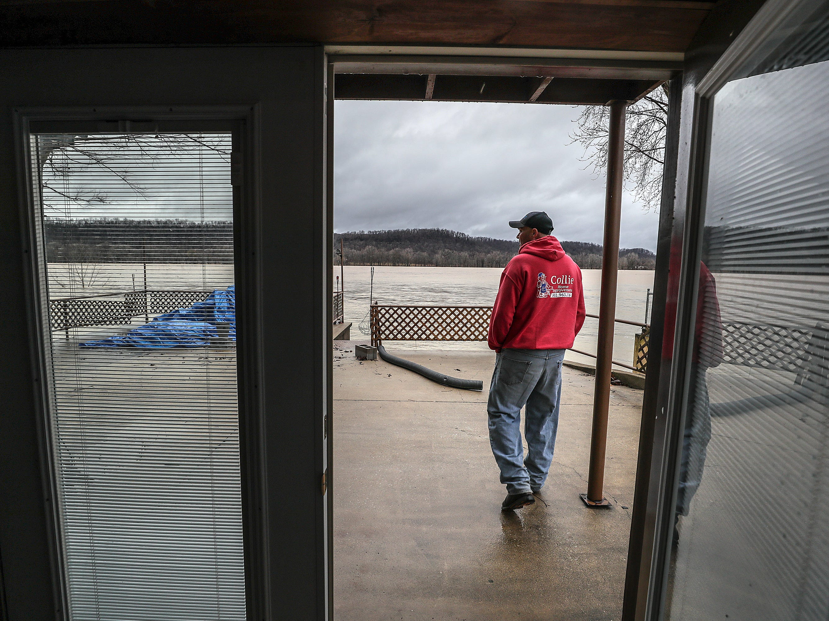 """West Point resident Mike Givins walks out along the back of his home.  """"Some times you have to pay Old Man River,"""" said Givins who is removing belongings from the lower level of his home in advance of the flooding.February 12, 2019"""
