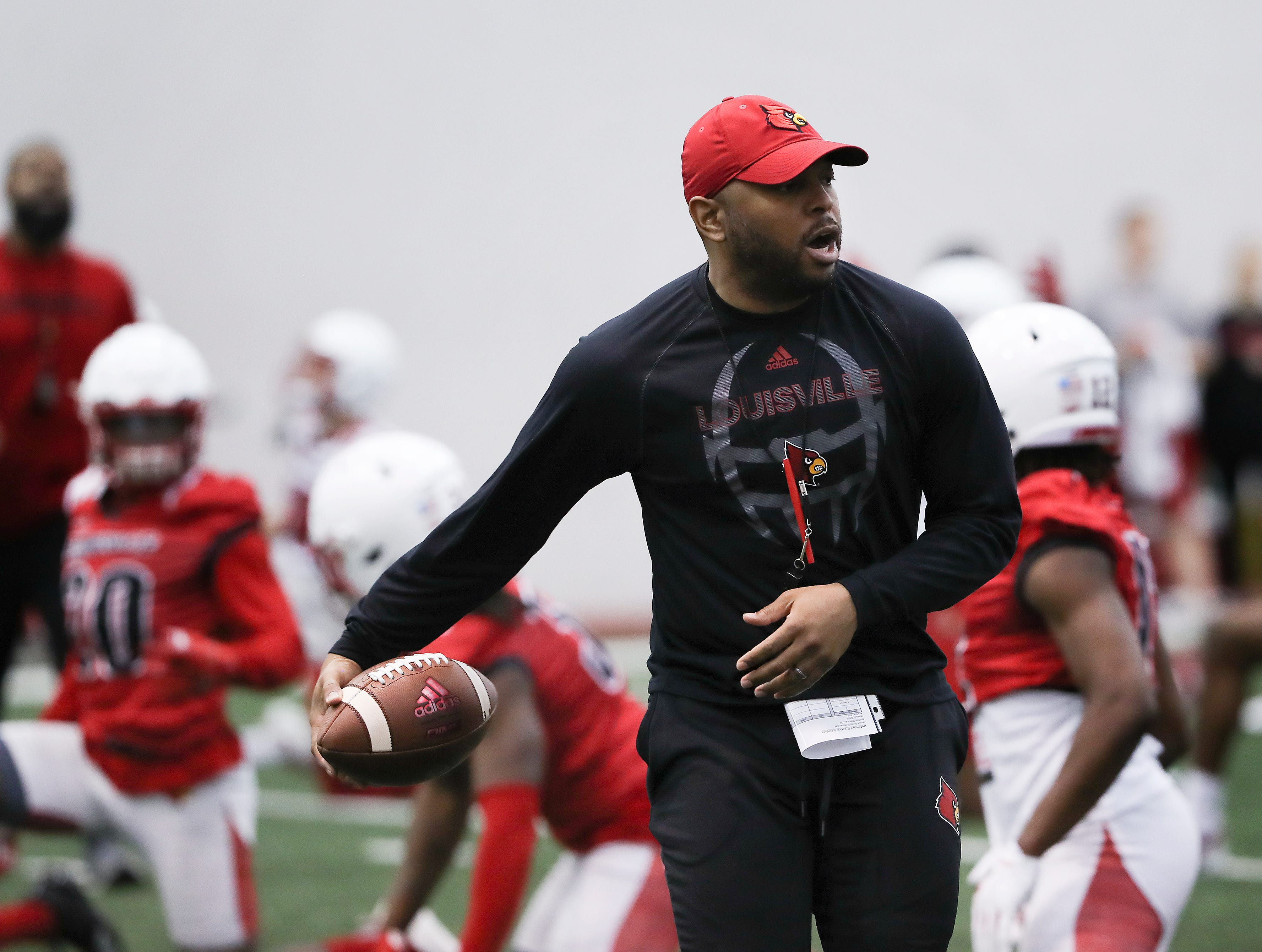 U of L defensive coordinator Bryan Brown conducted drills during practice at the Trager Center.