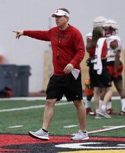 Louisville football coach Scott Satterfield directs a practice. Feb. 11, 2019