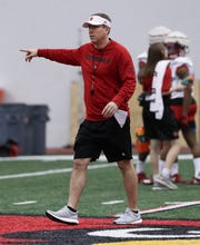 Louisville football coach Scott Satterfield directs a practice. Feb. 11, 2019