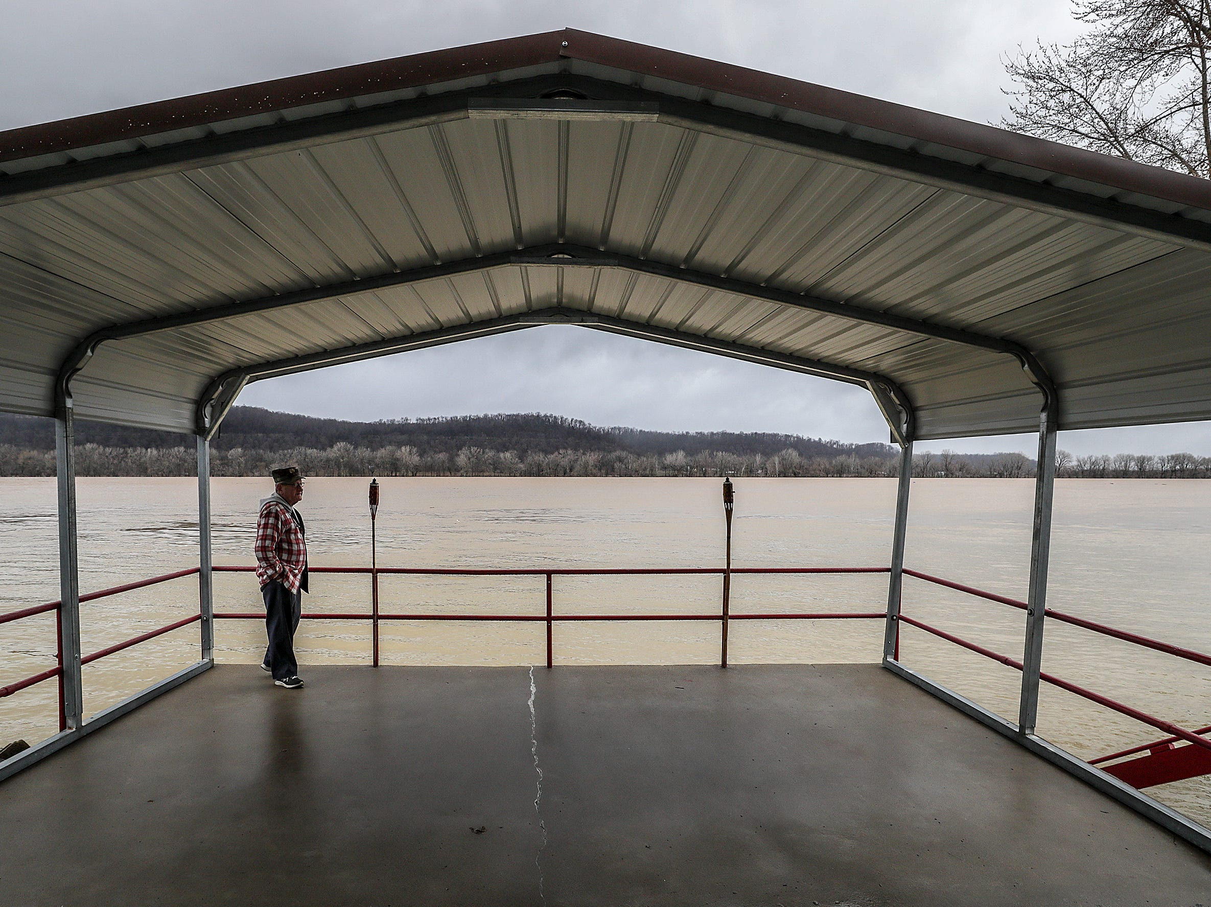 Long-time West Point resident Stan Madden looks out over an ever-encroaching Ohio River that will flood several homes in the small river town.February 12, 2019