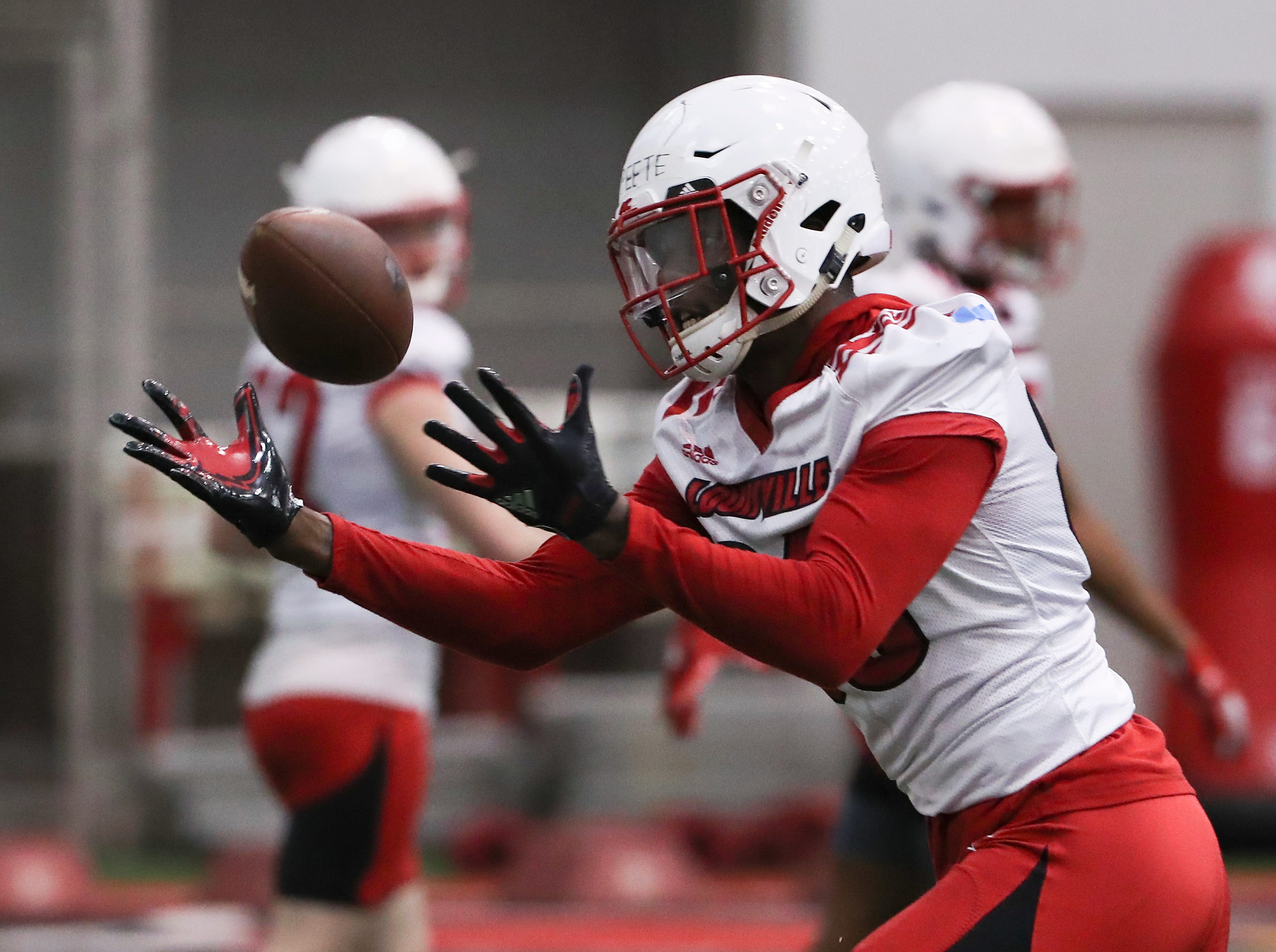 U of L's Devante Peete (86) hauled in a pass during practice at the Trager Center.
