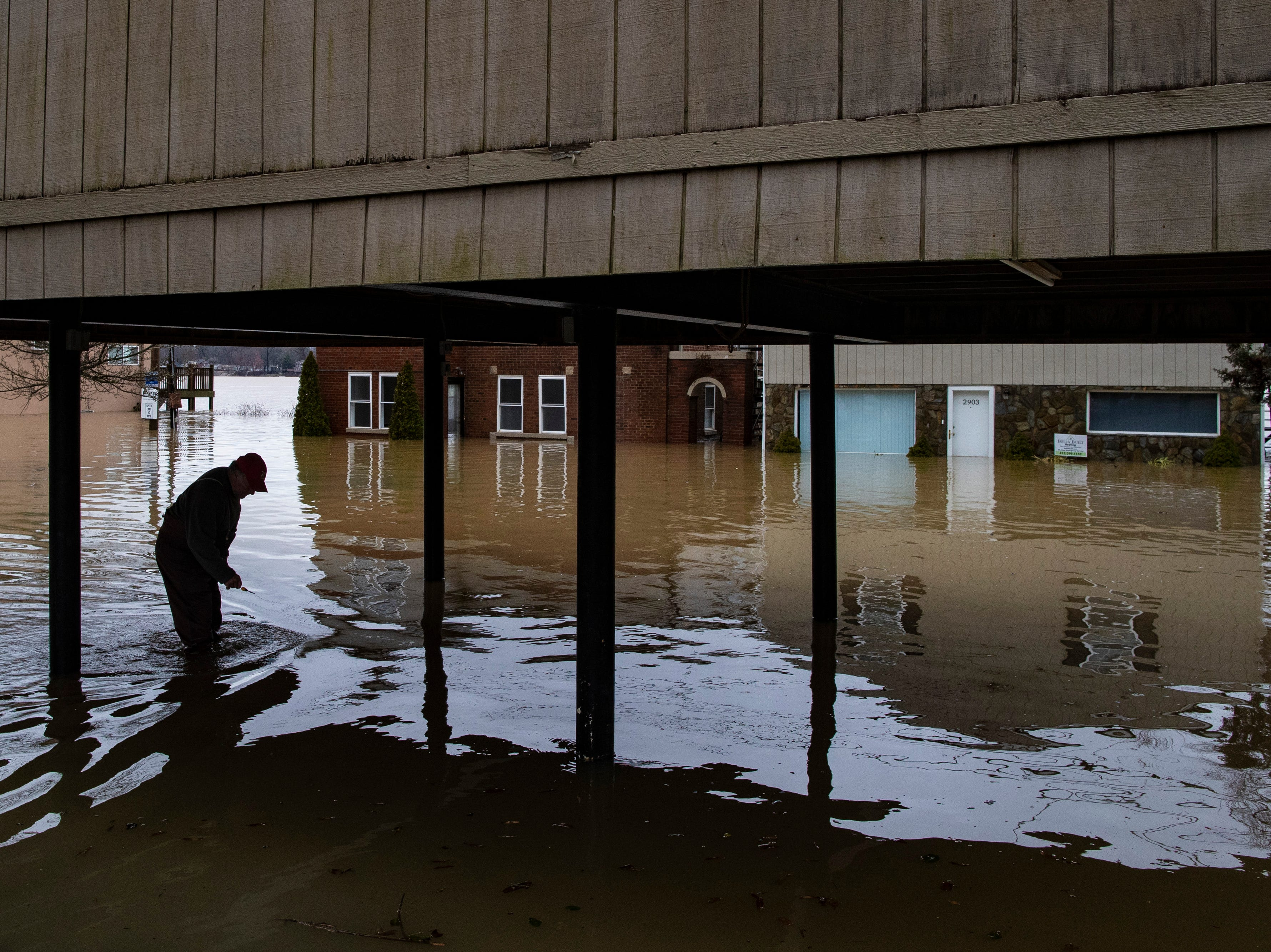 """Tony Kerger, 78, makes his way through high waters to his home off River Road as high waters on the Ohio River rose Tuesday. """"We've lived here 44 years,"""" Kerger said. """"Everybod about had their house put back together from last year and now we'll be doing it again."""" Feb. 12, 2019"""