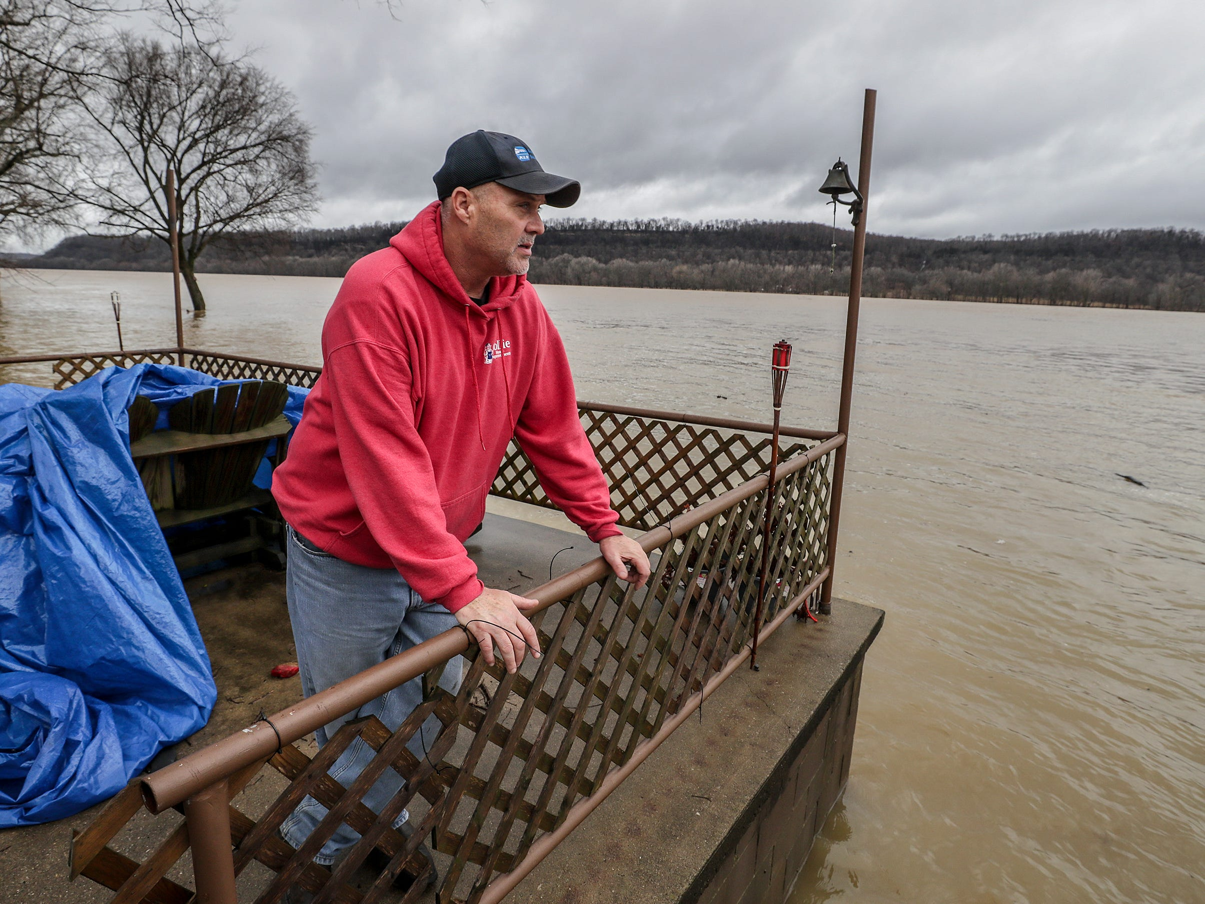 """West Point resident Mike Givins walks out along the back of his home.  """"Some times you have to pay Old Man River,"""" said Givins who is removing belongings from the lower level of his home in advance of the flooding.  The water is typically fifty yards from his back deck.February 12, 2019"""