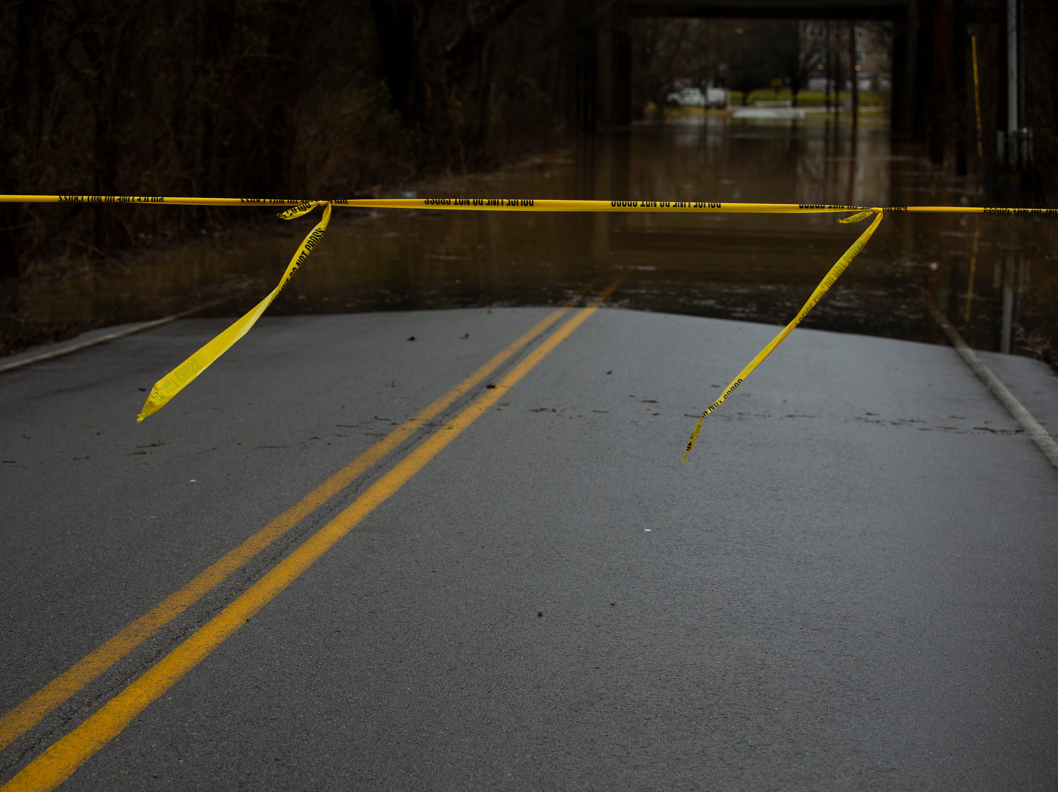 Roads are blocked off around River Road as high waters on the Ohio River rose Tuesday. Feb. 12, 2019