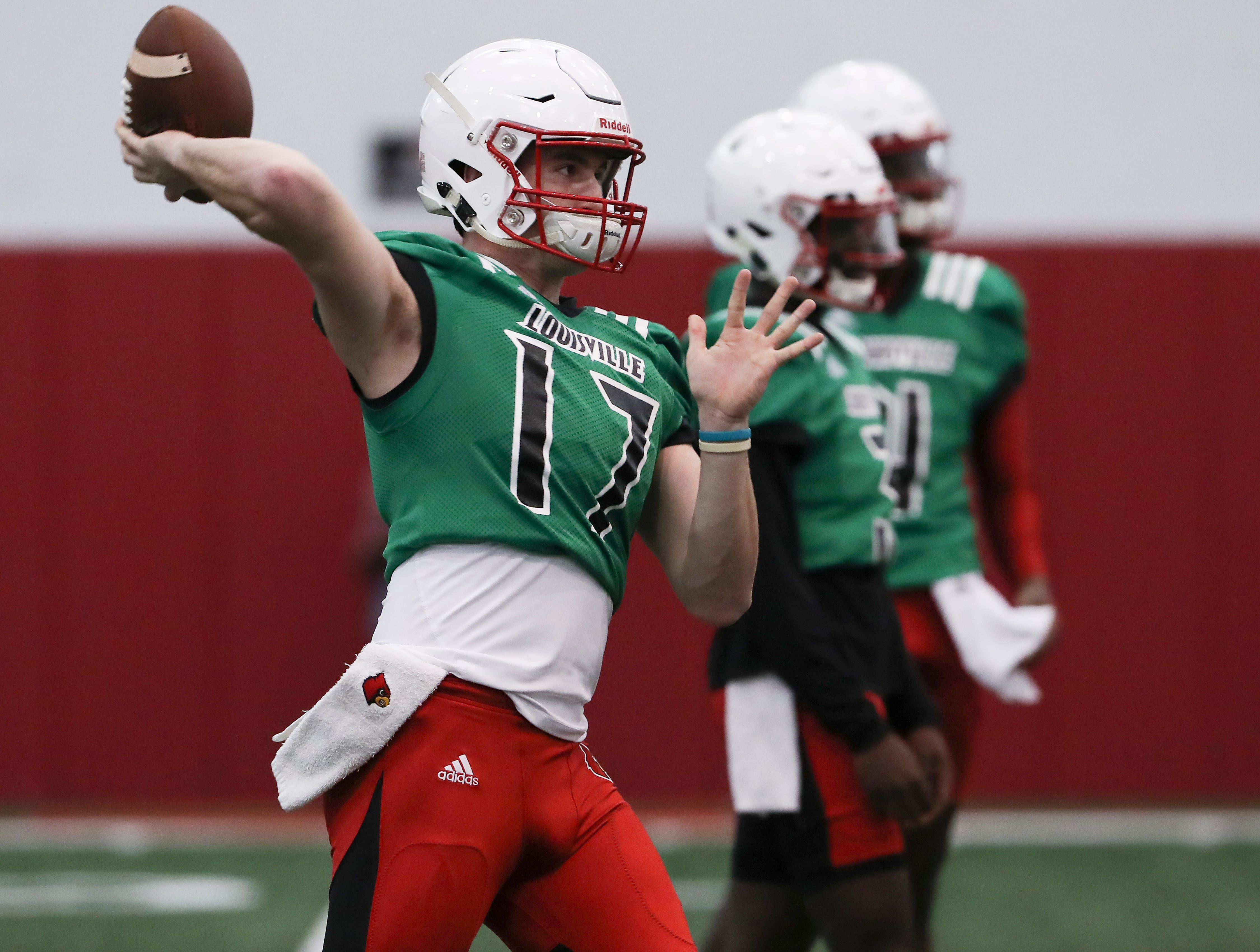 U of L QB Drew Zaubi (17) performs a pass drill during practice at the Trager Center.