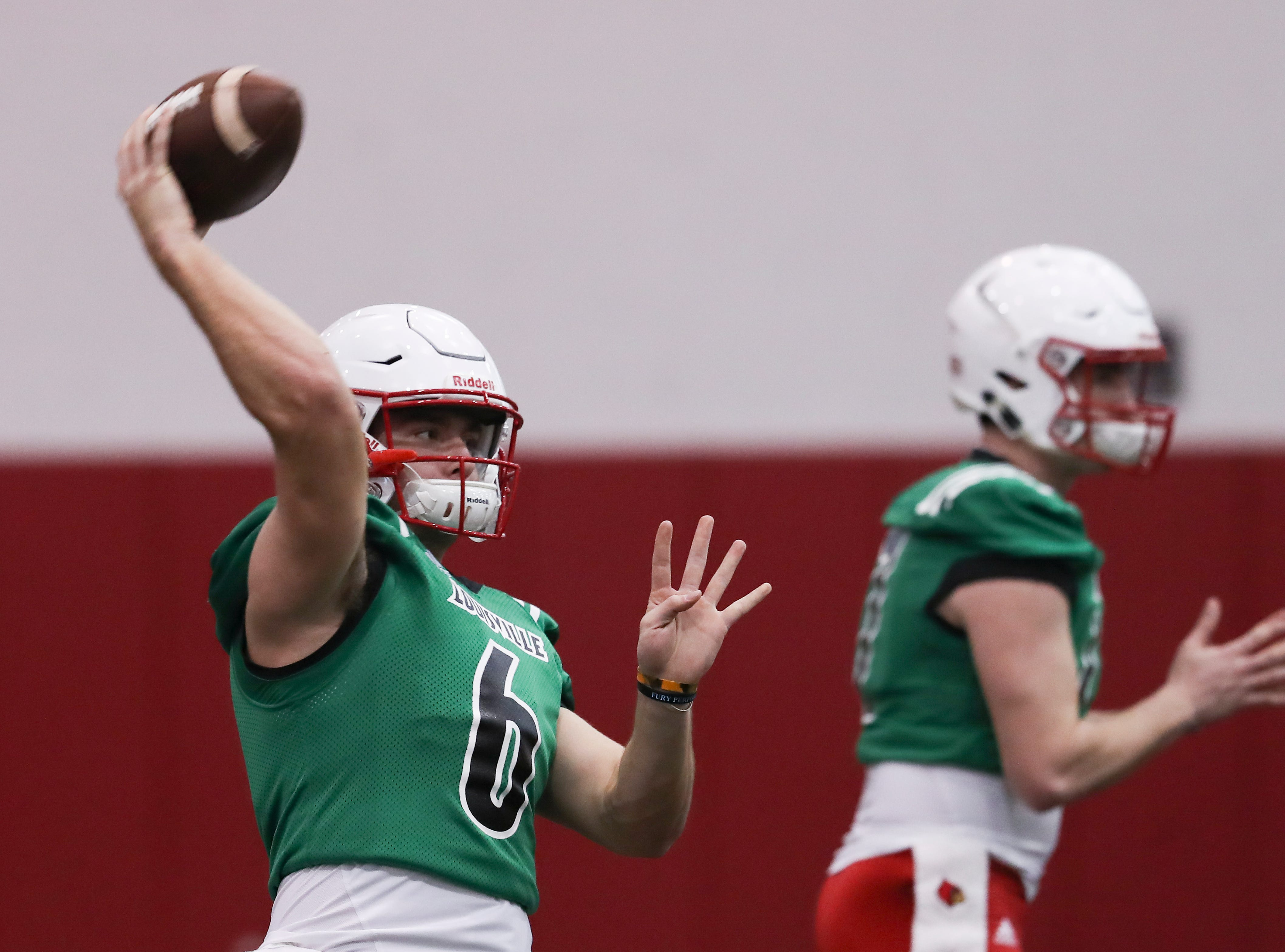 U of L QB Evan Conley (6) performs a pass drill during practice at the Trager Center.
