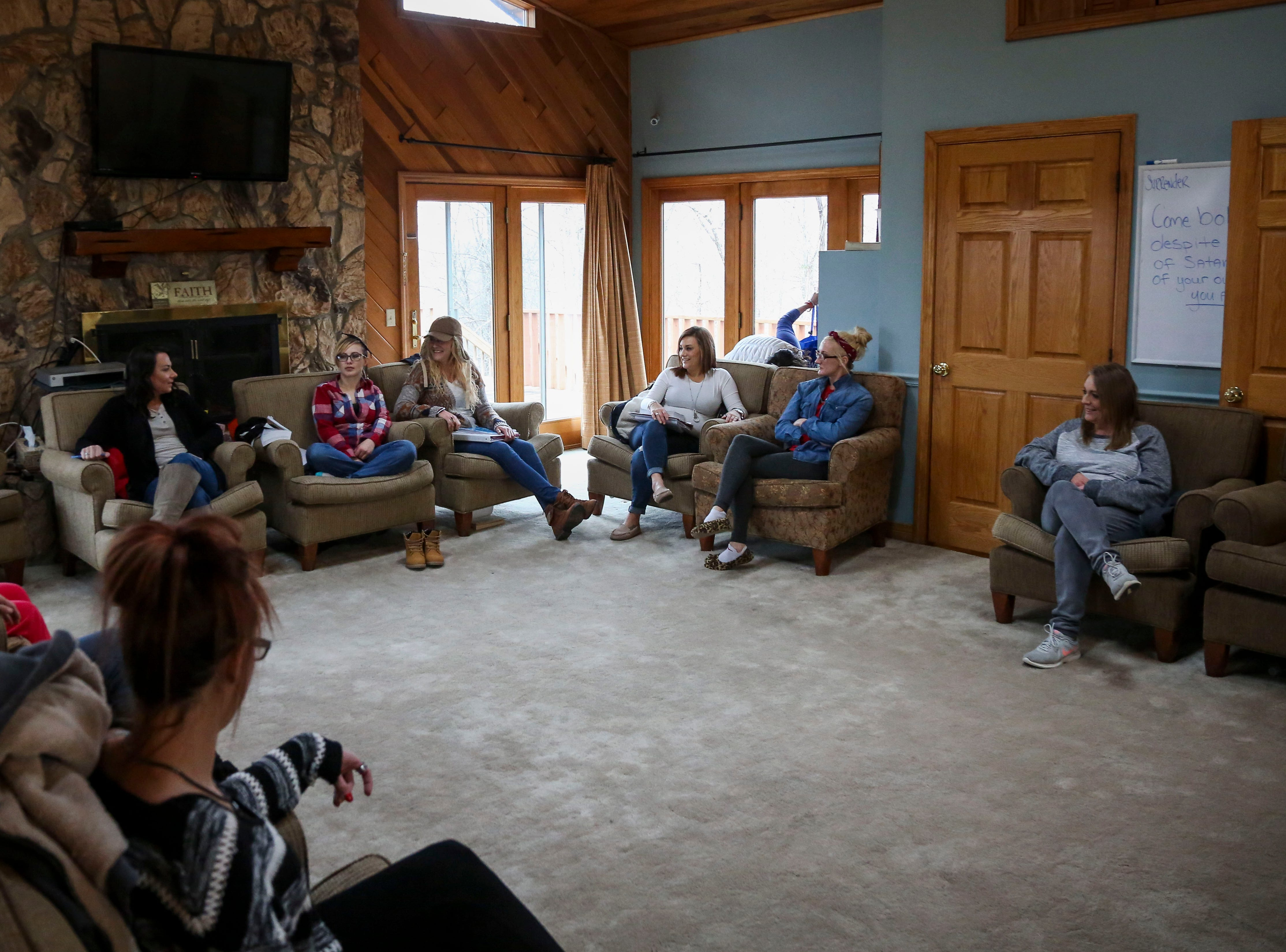 Women talk during a group session at Karen's Place, a drug rehab program run by Addiction Recovery Care (LLC), in Louisa, Kentucky, on Jan. 10, 2019.