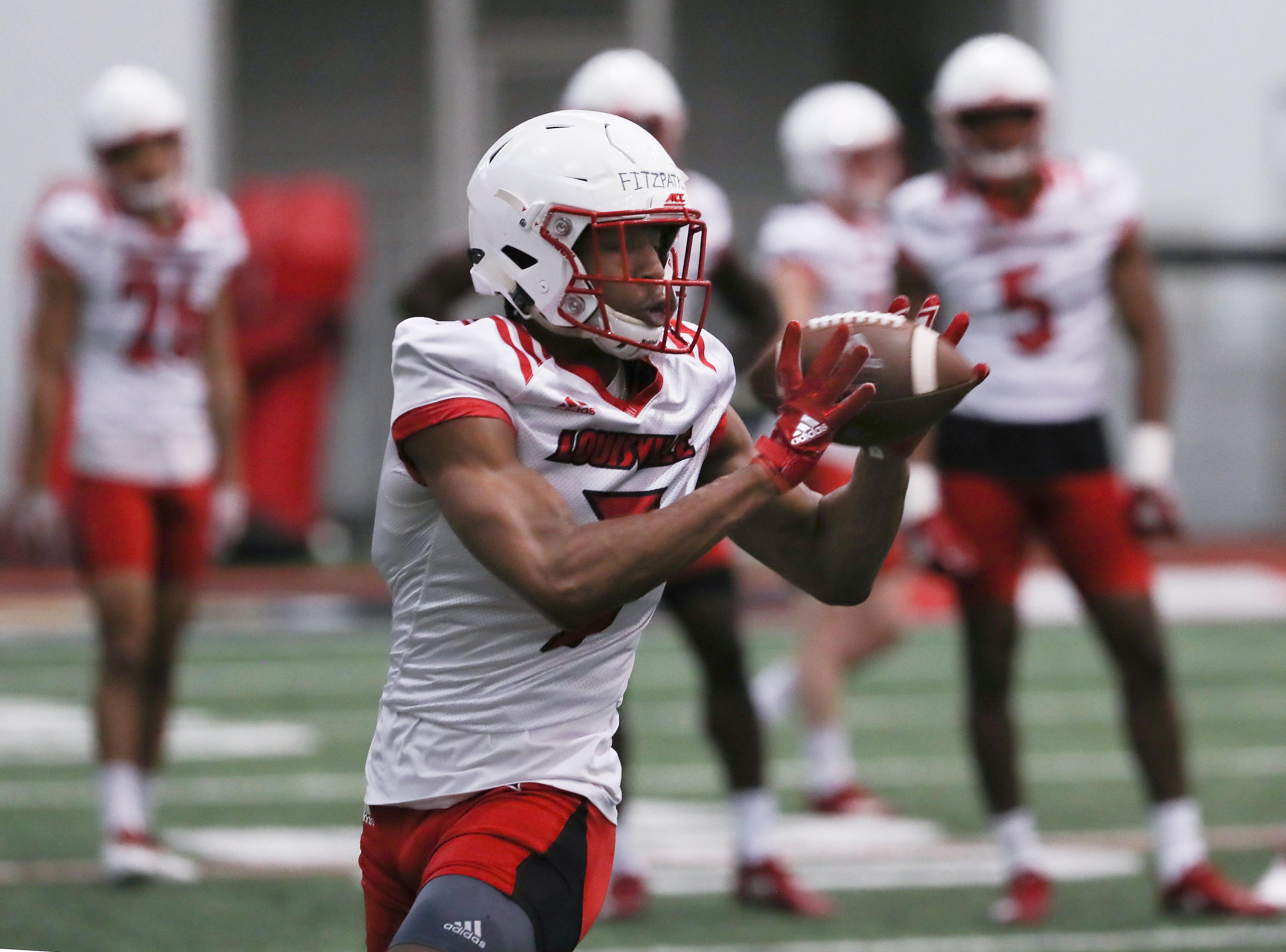 U of L's Dez Fitzpatrick (7) ran a pass route during practice at the Trager Center.
