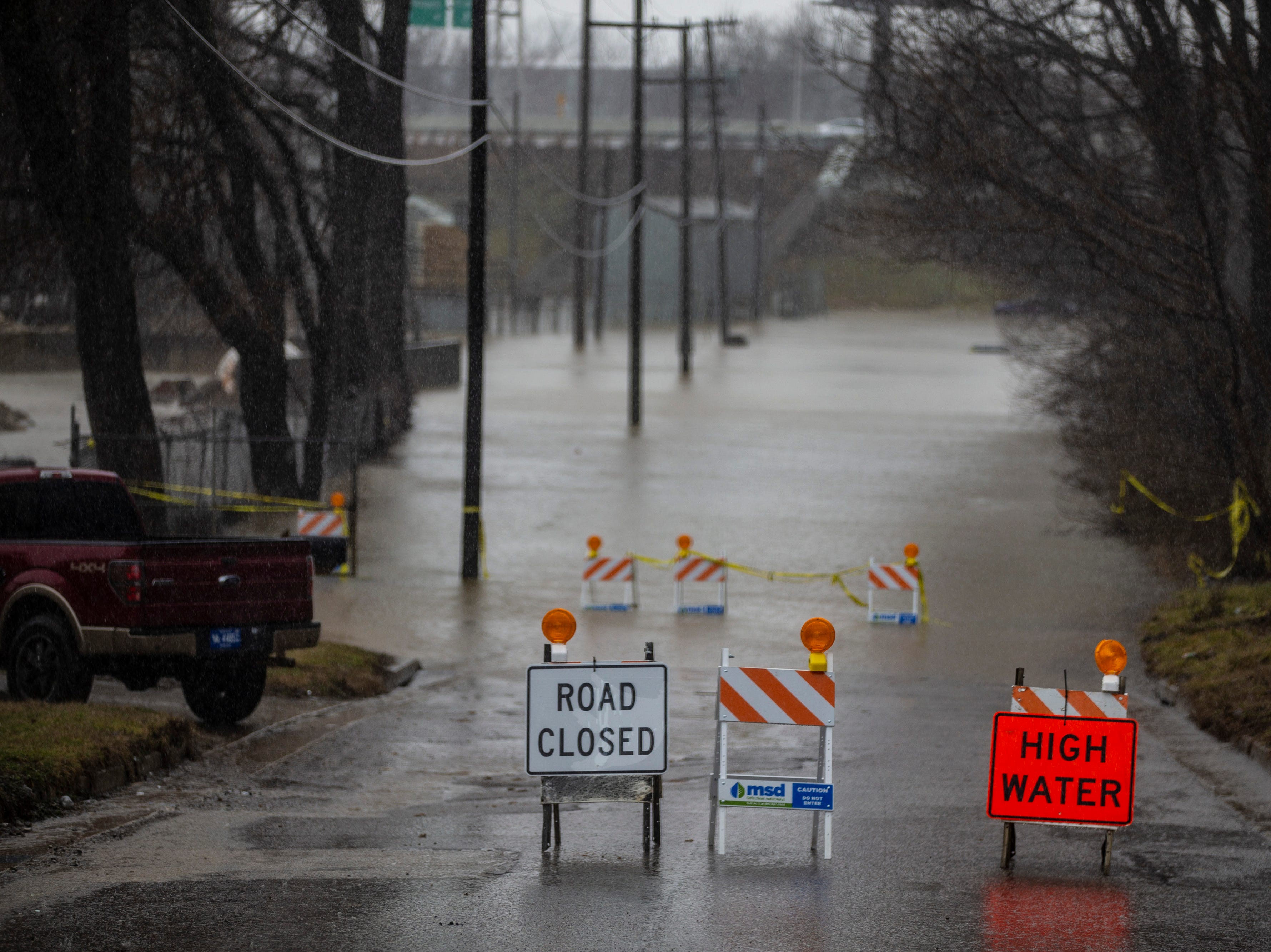 High water signs on Frankfort Avenue on Tuesday afternoon in Louisville. Feb. 12, 2019