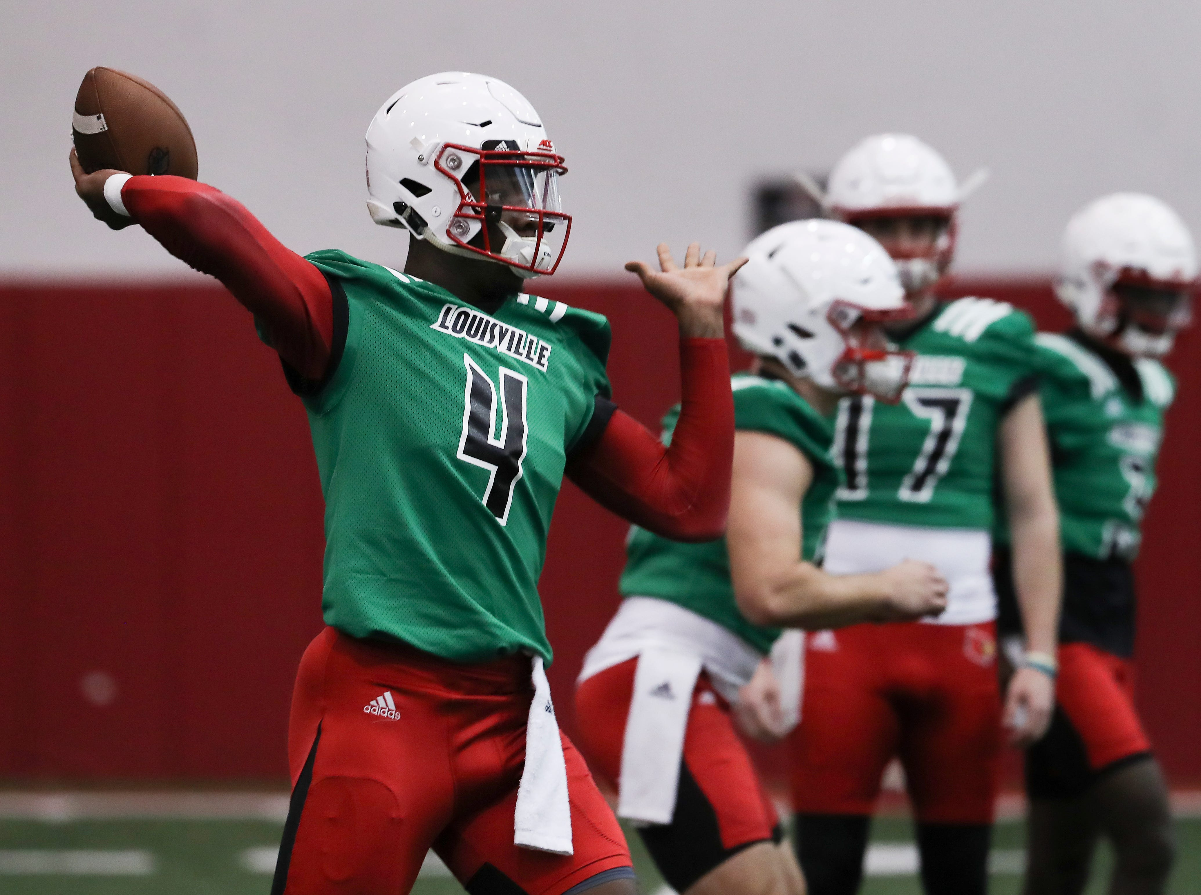 U of L QB Jawon Pass (4) performs a pass drill during practice at the Trager Center.